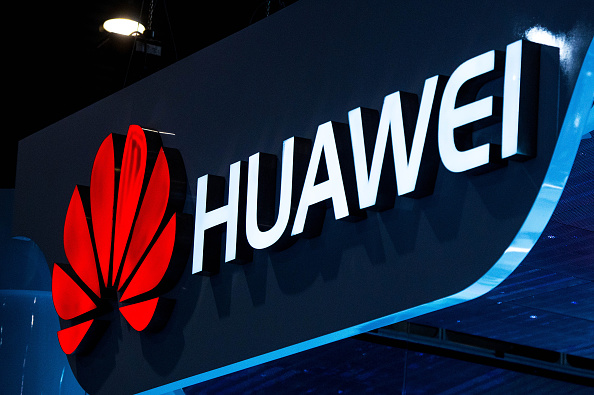 A logo sits illuminated outside the Huawei pavilion during the second day of the Mobile World Congress 2015 at the Fira Gran Via complex on March 3, 2015 in Barcelona, Spain