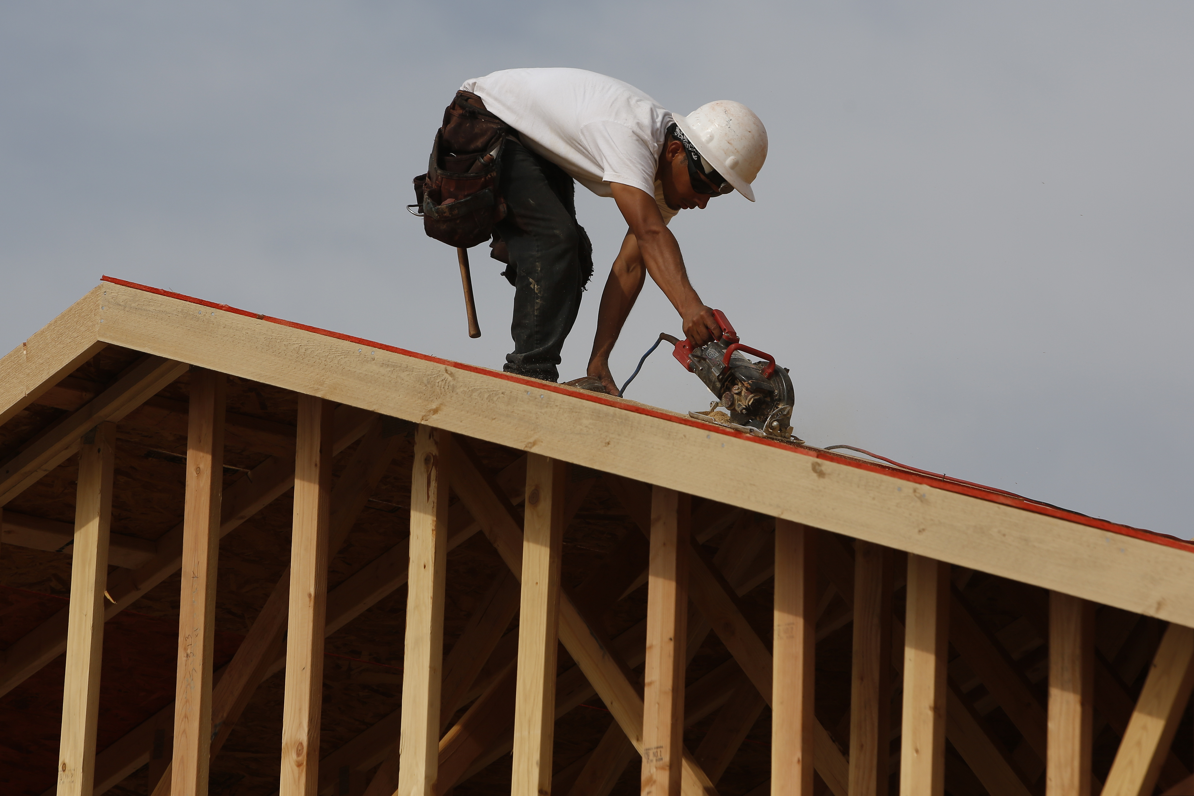 A worker builds a new Toll Brothers home.