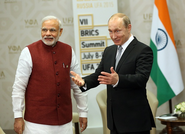 Russian President Vladimir Putin, right, greets Indian Prime Minister Narendra Modi, left, during their bilateral meeting at the BRICS 2015 Summit on July 8, 2015 in Ufa, Russia