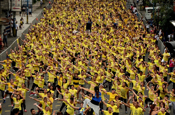Filipino residents participate in a Zumba class in an attempt to break the Guinness World Record in Mandaluyong on July 19, 2015