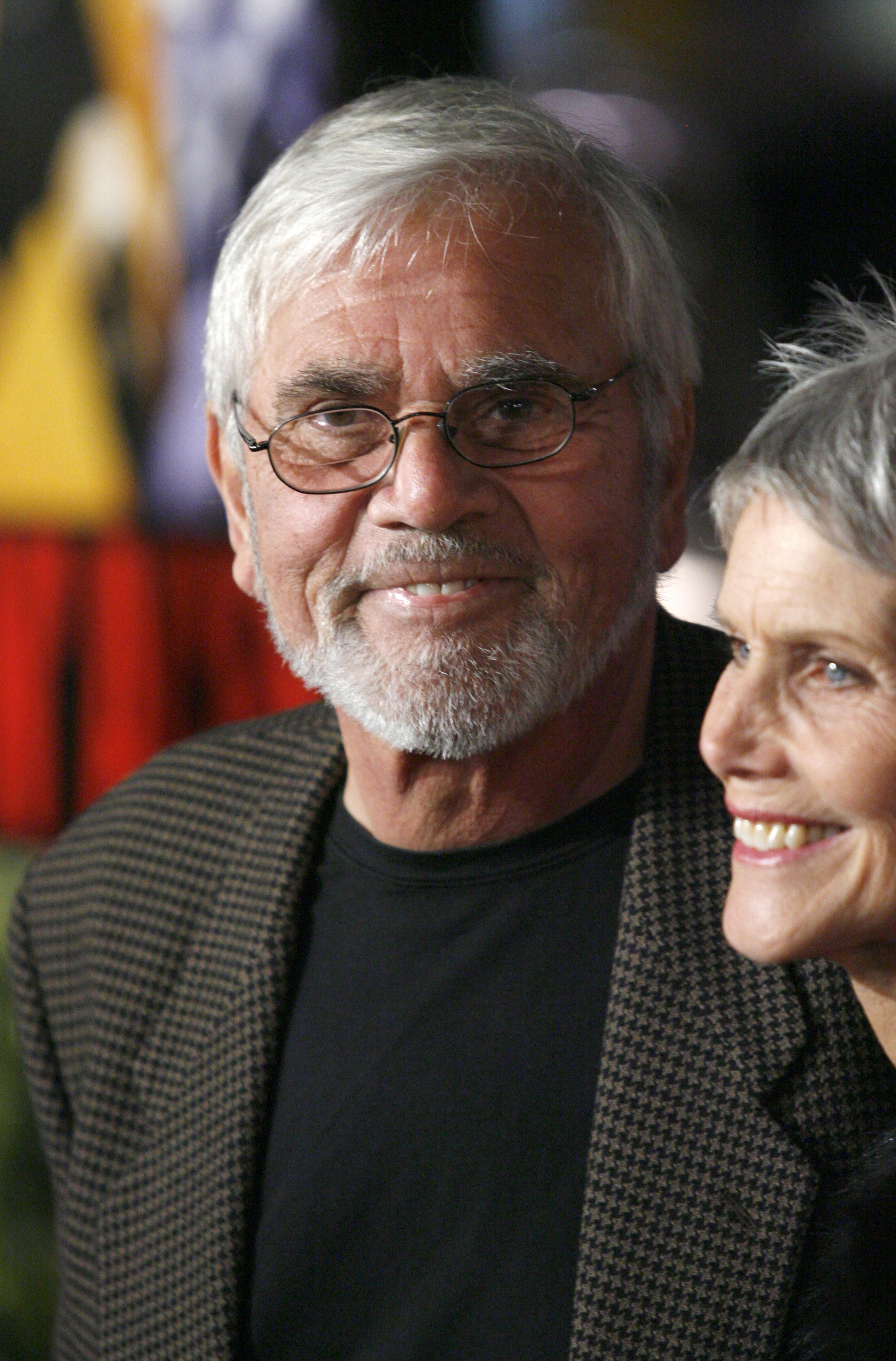 Alex Rocco and wife Shannon Wilcox pose for photographers during the premiere of Smokin' Aces in Hollywood on Jan. 18, 2007