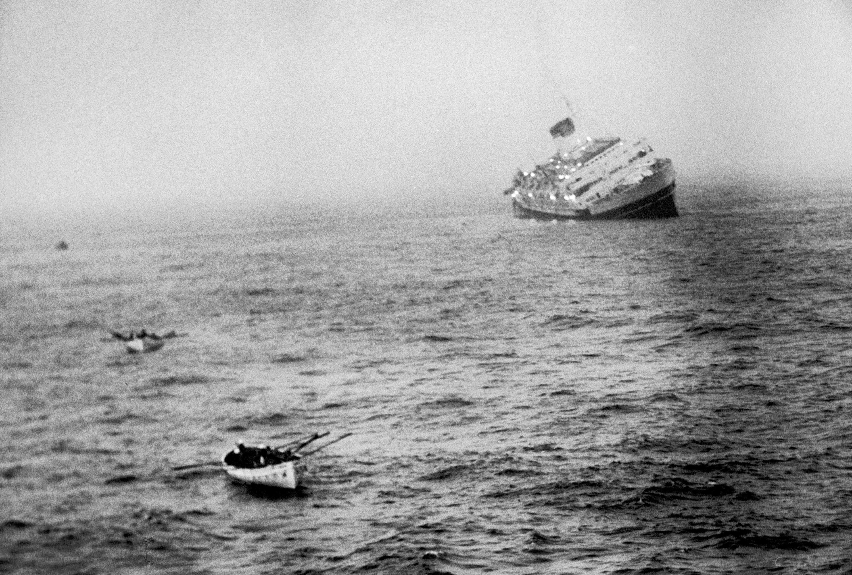 Italian liner Andrea Doria sinking in Atlantic after collision w. Swedish ship `Stockholm'.