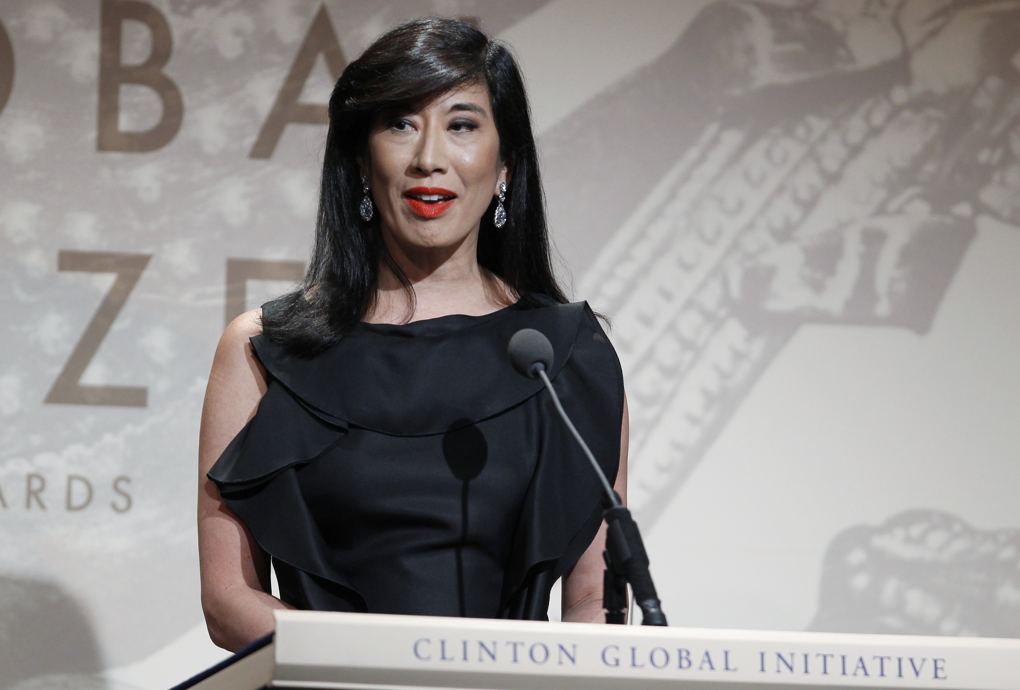 Andrea Jung, CEO of Avon Products Inc., accepts the Leadership in the Corporate Sector award during the Clinton Global Citizen Award ceremony marking the culmination of the Clinton Global Initiative in New York