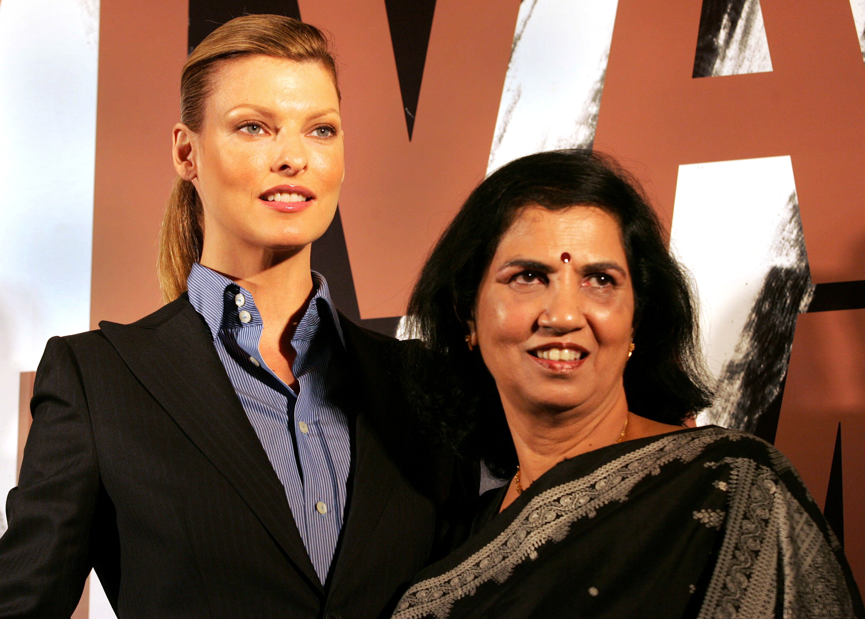 Canadian supermodel Linda Evangelista, left, and Director of Y.R. Gaitonde Center for AIDS Research and Education Suniti Solomon at a charity function in Mumbai, India on Oct. 21, 2005