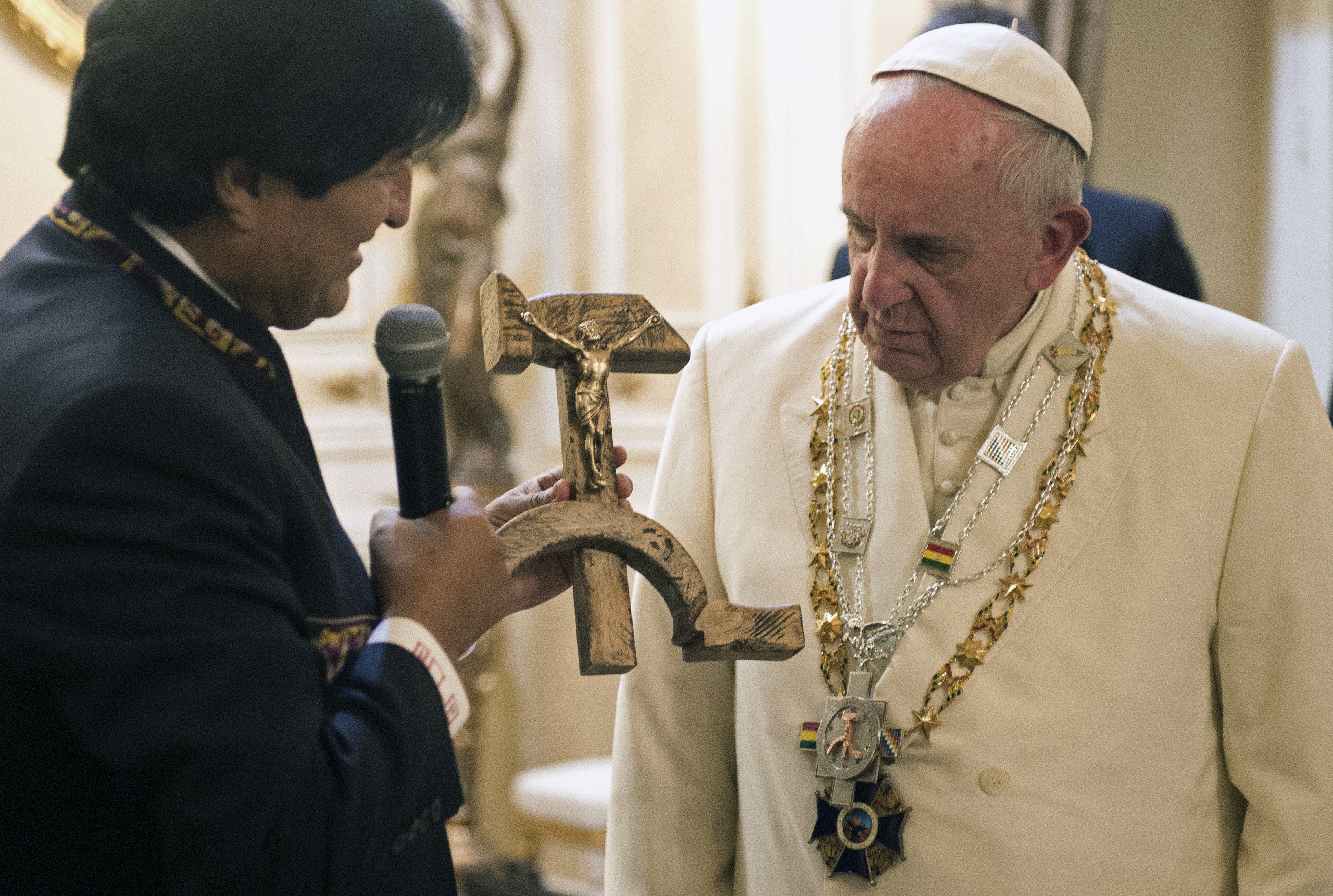 Bolivian President Evo Morales presents Pope Francis with a crucifix carved into a wooden hammer and sickle, in La Paz, Bolivia, on July 8, 2015.