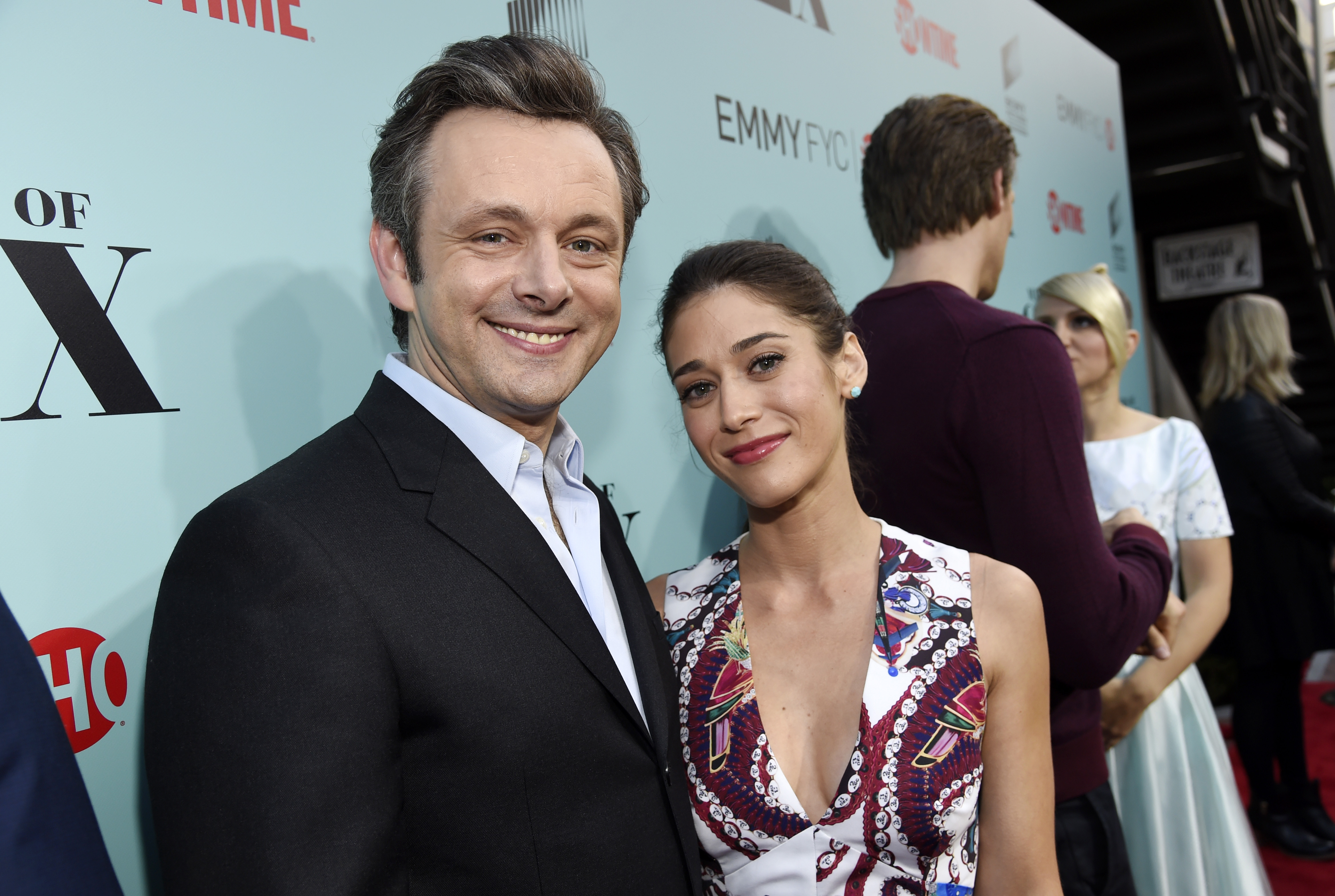 Michael Sheen, left, and Lizzy Caplan, cast members in the Showtime series  Masters of Sex,  pose together at a screening and panel discussion for the show at Sony Pictures Studios on Tuesday, May 5, 2015, in Culver City, Calif.