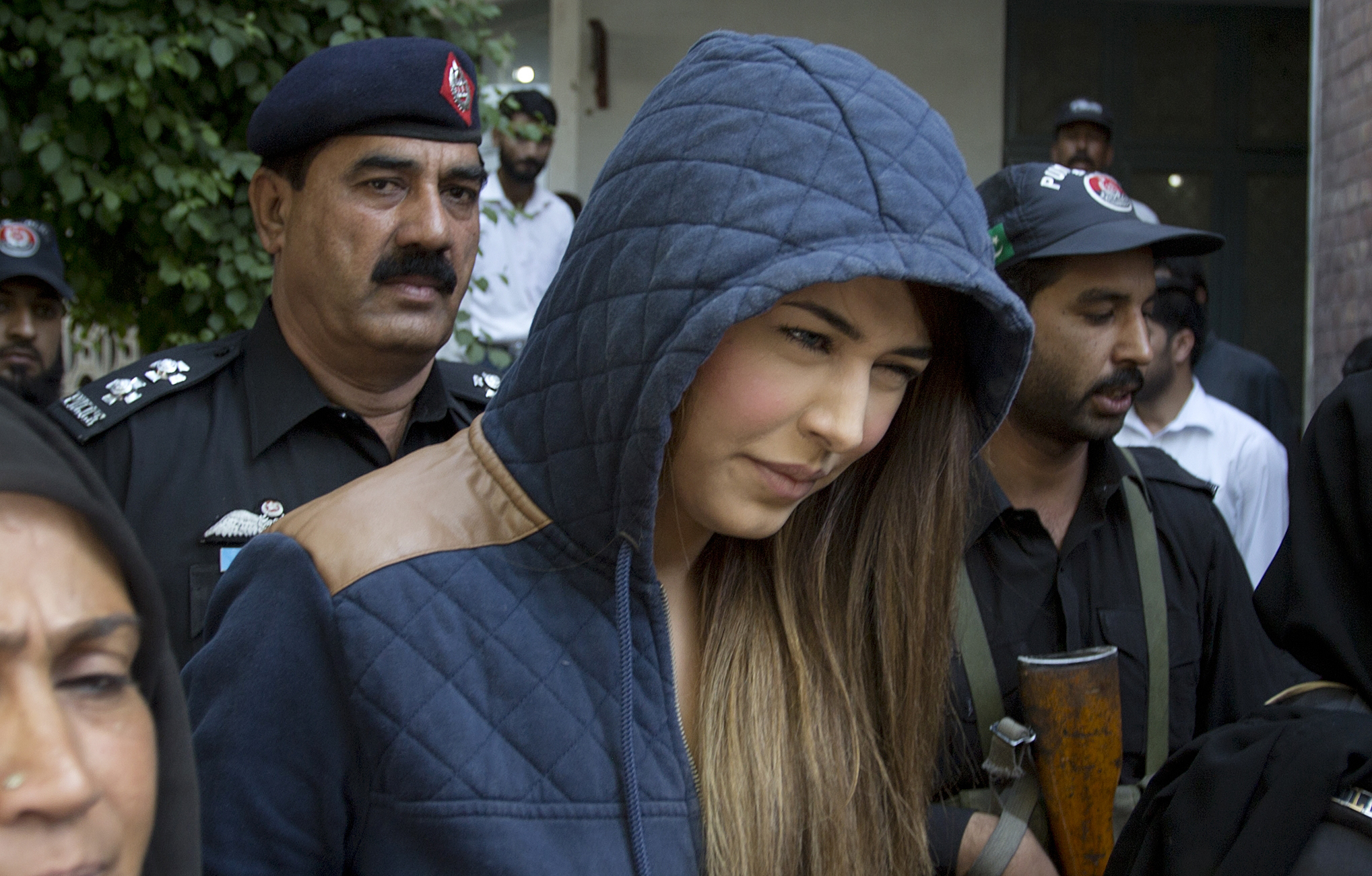 Police officers escort Pakistan's supermodel Ayaan Ali to a court under tight security in Rawalpindi, Pakistan, on June 1, 2015