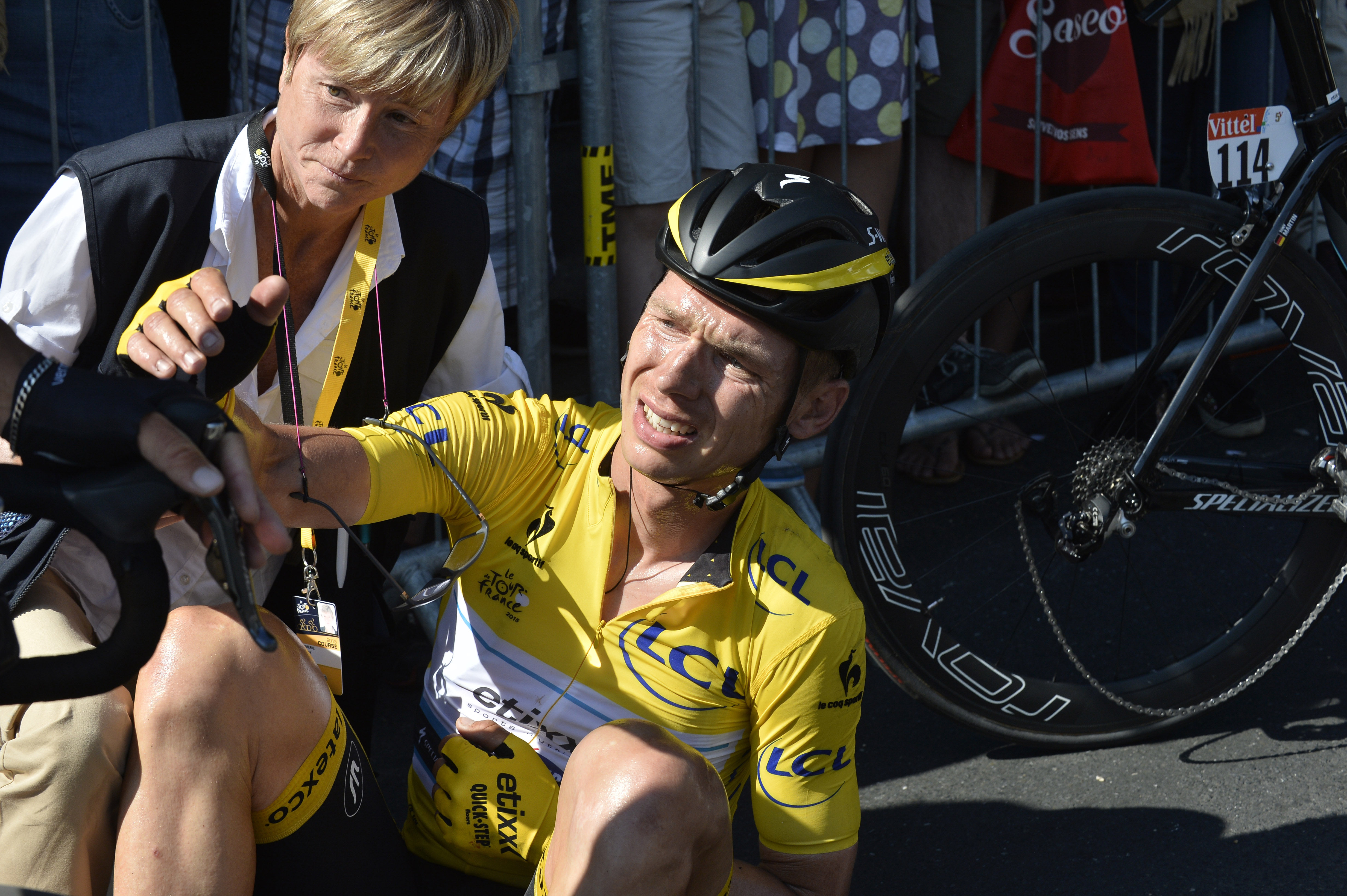 Germany's Tony Martin, wearing the overall leader's yellow jersey, lies on the road with a broken collar bone after crashing in the last kilometers of the sixth stage of the Tour de France cycling race over 191.5 kilometers (119 miles) with start in Abbeville and finish in Le Havre, France, July 9, 2015