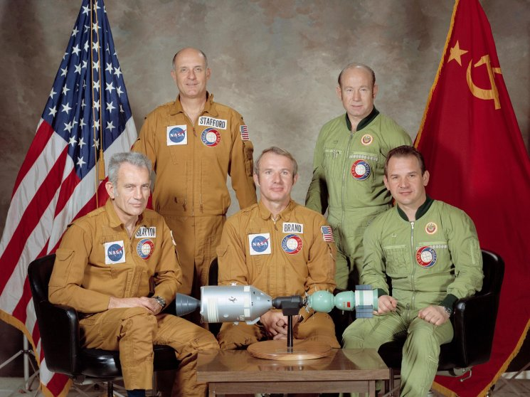 The U.S.-USSR crew for the 1975 Apollo Soyuz Test Project mission: astronaut Tom Stafford (standing on left), commander of the American crew; cosmonaut Alexei Leonov (standing on right), commander of the Soviet crew; astronaut Donald Slayton (seated on left), docking module pilot of the American crew; astronaut Vance Brand (seated in center), command module pilot of the American crew; and cosmonaut Valeriy Kubasov (seated on right), engineer on the Soviet crew.