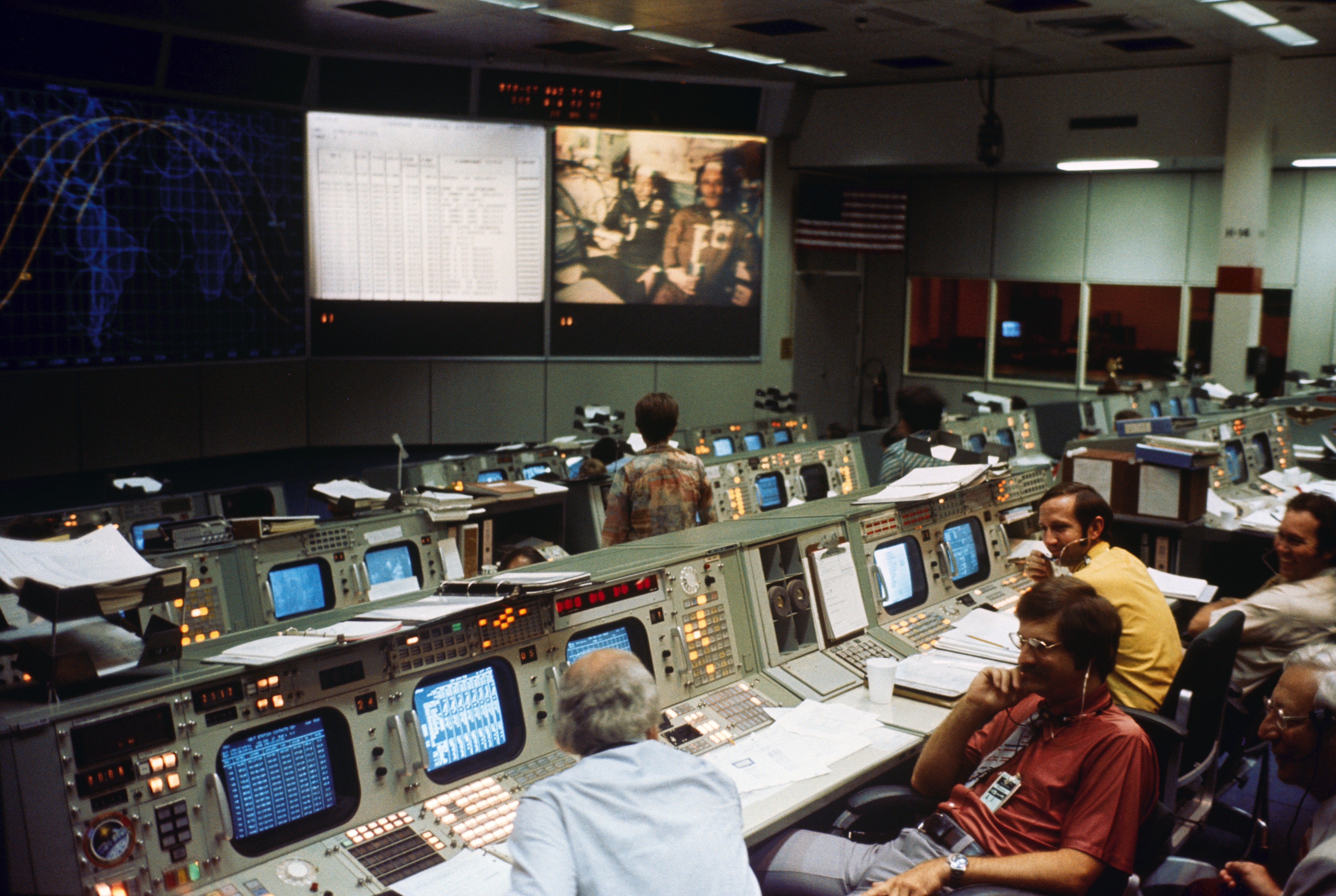 Activity inside Mission Control in Houston during the Apollo Soyuz Test Project docking mission.