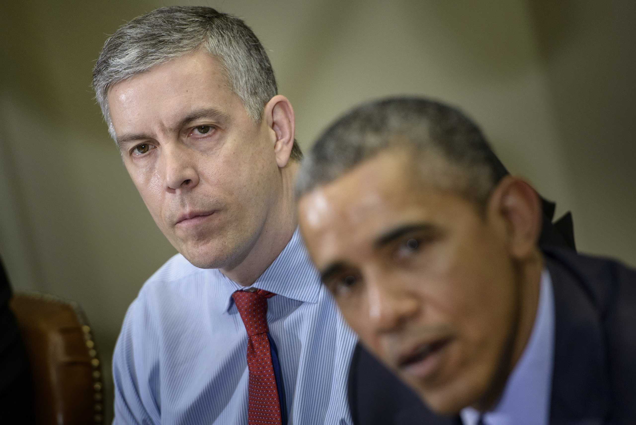 Secretary of Education Arne Duncan with President Obama at the White House, in March 2015.