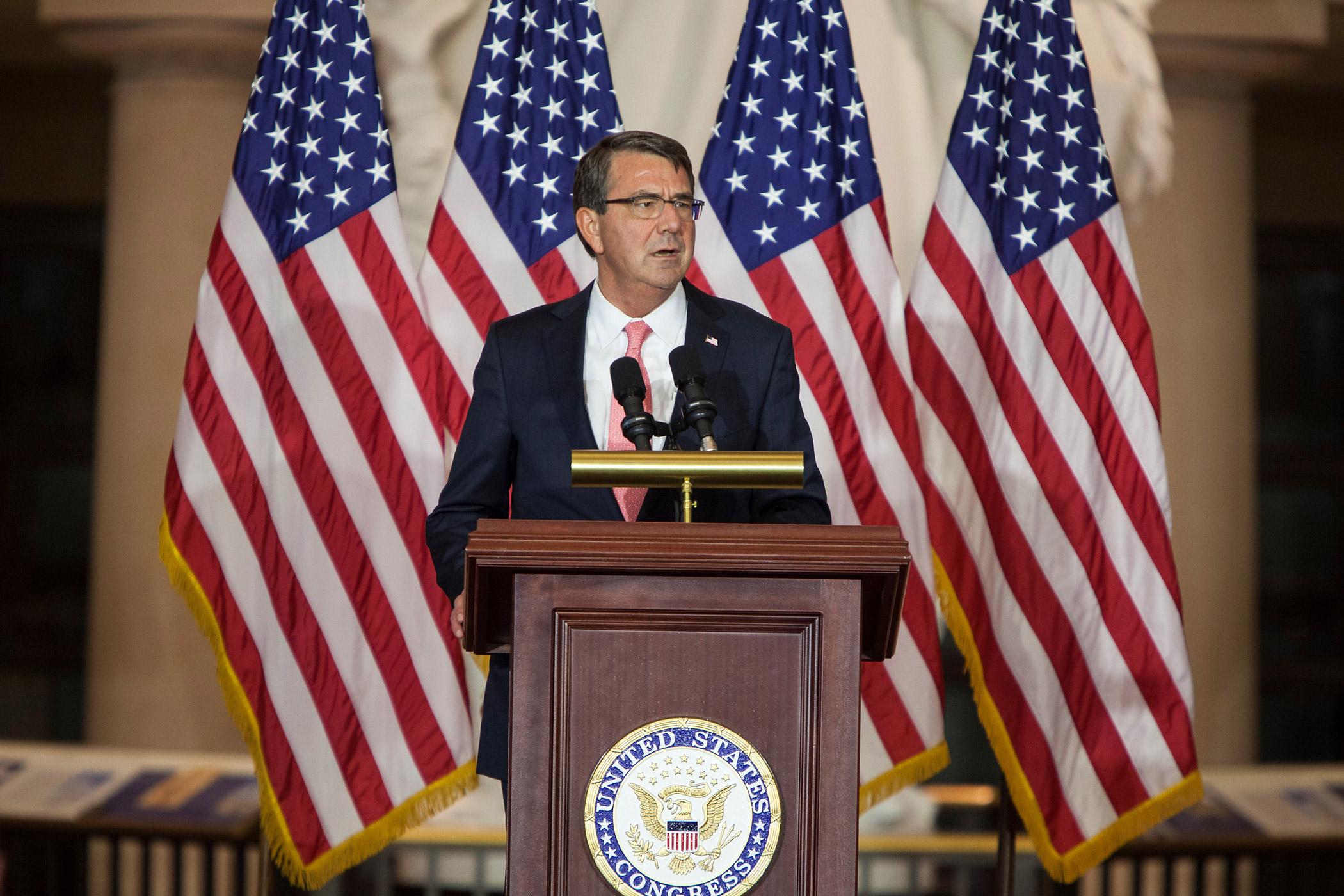 Secretary of Defense Ash Carter speaks to veterans during the Vietnam War Commemoration ceremony at the Capitol in Washington, DC on July 8, 2015.
