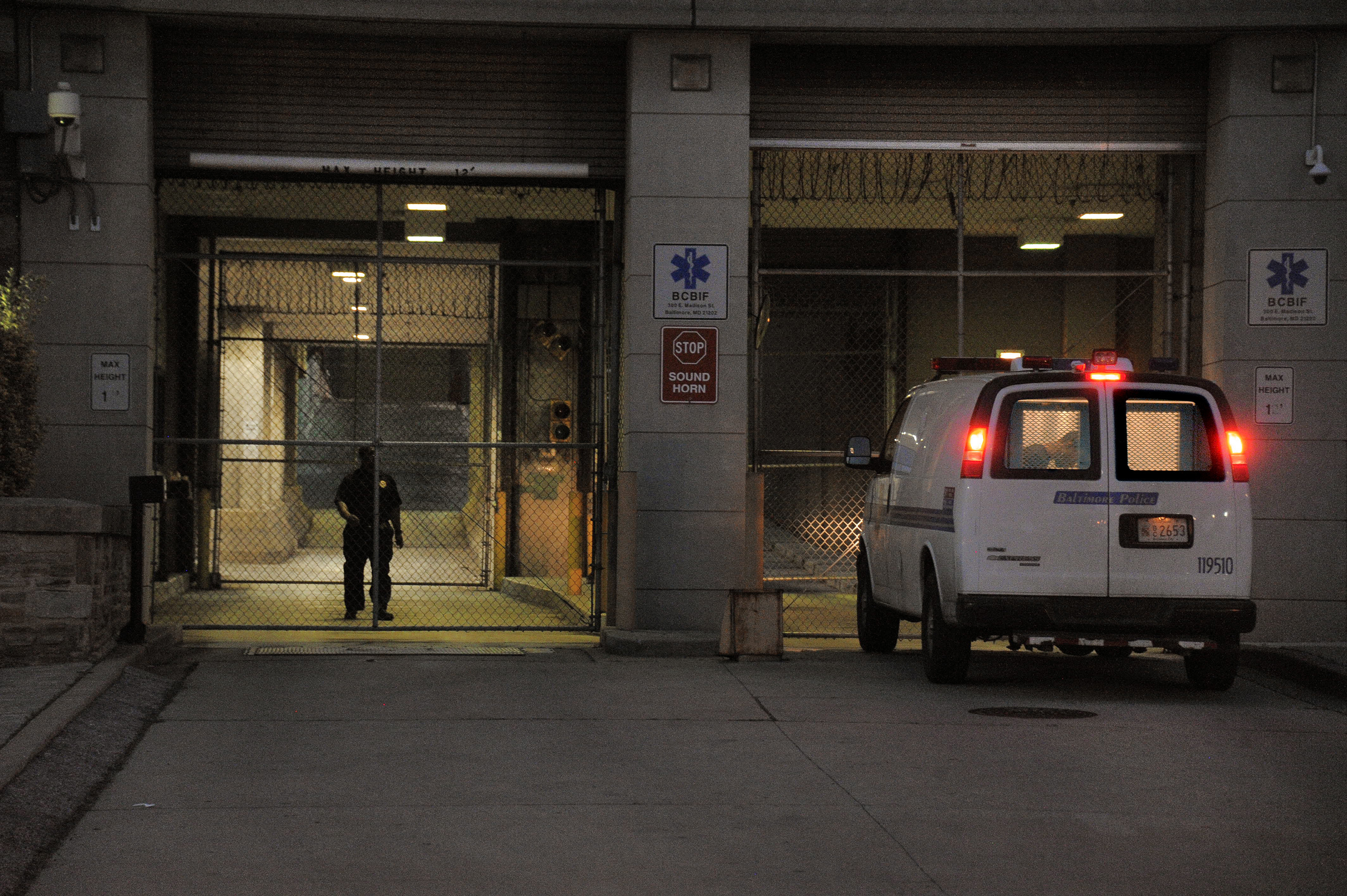 A Baltimore Police transfer van pulls into the Baltimore Central Booking and Intake Center on May 7, 2015.