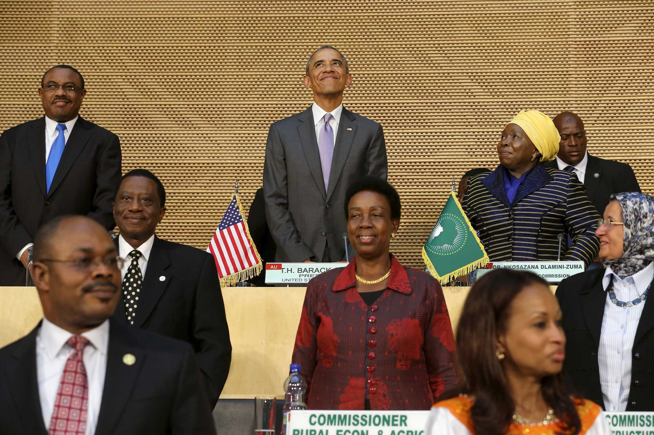 President Barack Obama flanked by Ethiopia's Prime Minister Hailemariam Desalegn (top left) and African Union Chairperson Nkosazana Dlamini-Zuma (top right), arrives to deliver remarks at the African Union in Addis Ababa on July 28, 2015.