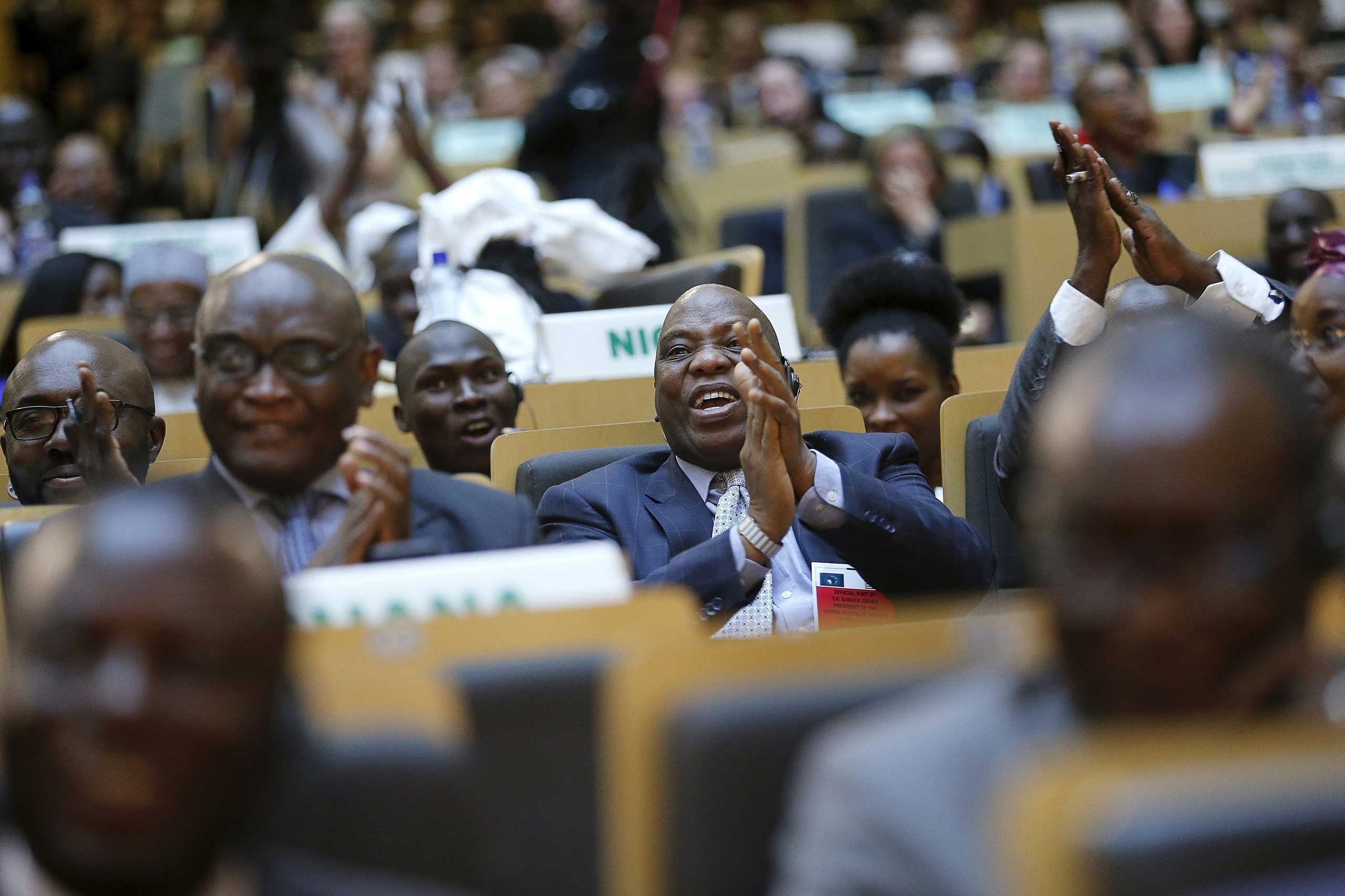Delegates react to remarks by President Barack Obama at the African Union in Addis Ababa on July 28, 2015.