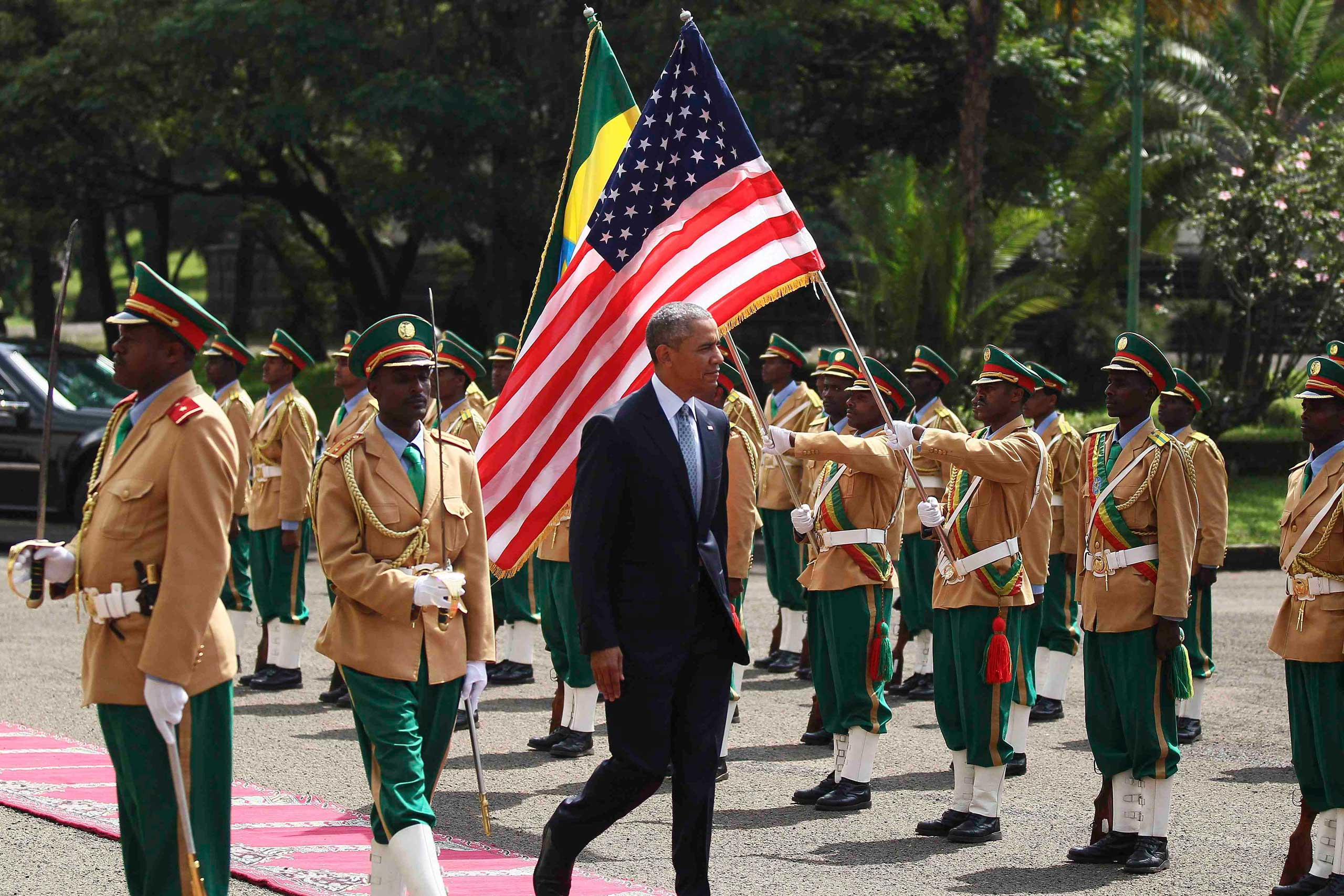 President Barack Obama reviews a marching band during a welcome ceremony at the National Palace in Addis Ababa on July 27, 2015.