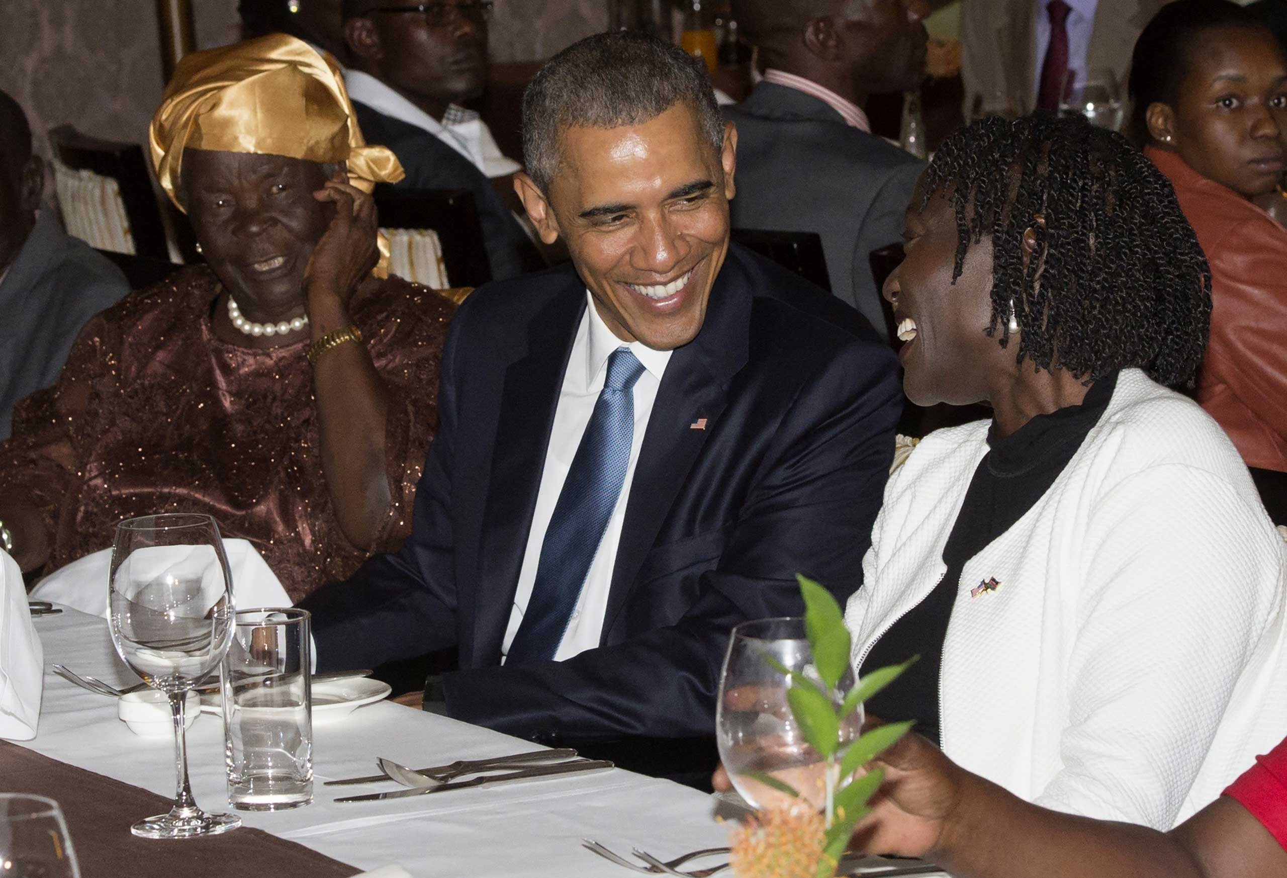 President Barack Obama sits with his step-grandmother, Mama Sarah and half-sister Auma Obama, during a gathering of extended family at his hotel in Nairobi on July 24, 2015.