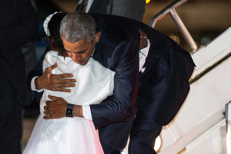 Eight-year-old Joan Wamaitha is hugged by President Barack Obama as he arrives at the Jomo Kenyatta International Airport in Nairobi on July 24, 2015.