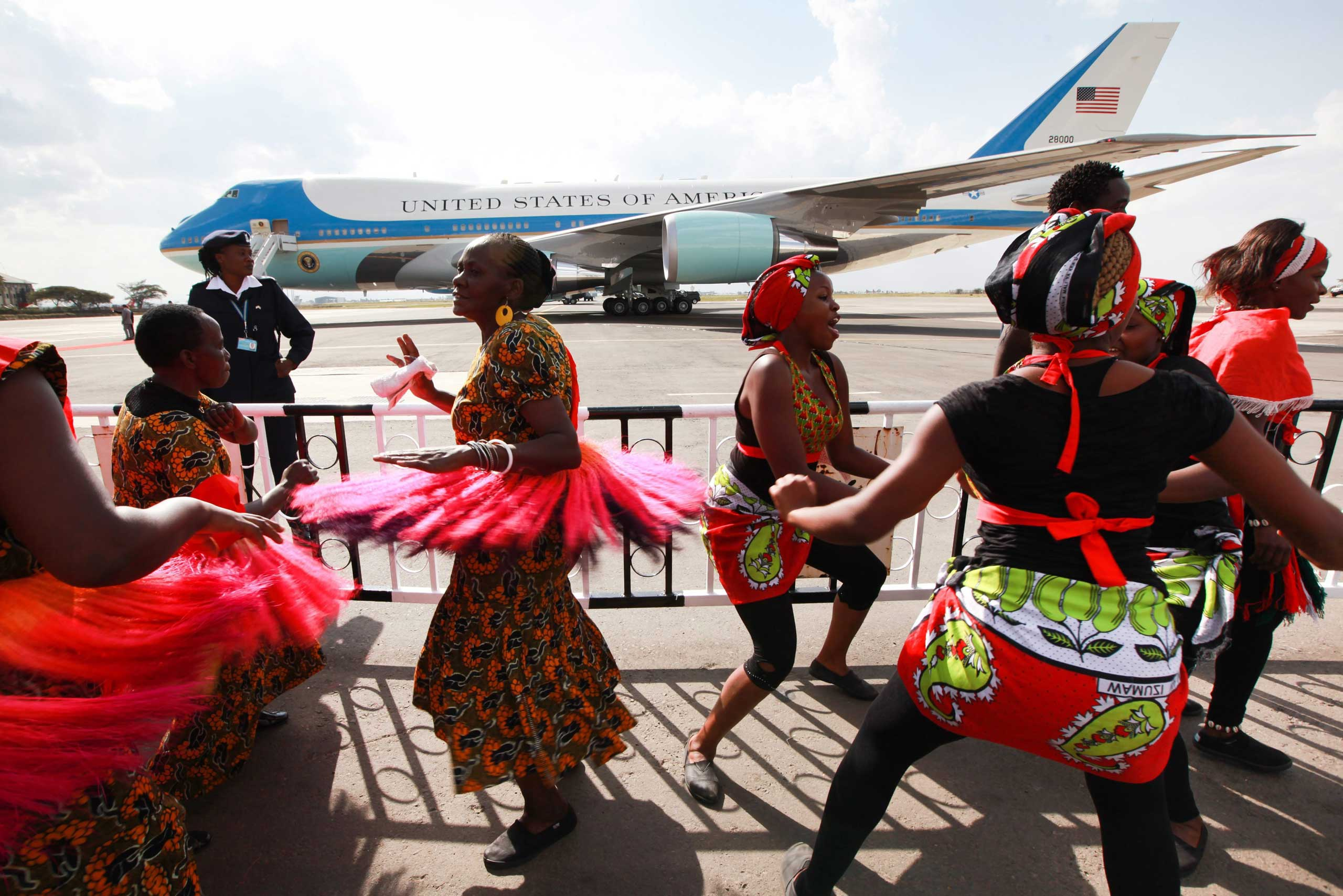 Kenyan traditional dancers sing as they wait to entertain President Barack Obama upon his arrival to board Air Force One for his departure to Ethiopia, at the Jomo Kenyatta International Airport in Nairobi on July 26, 2015.