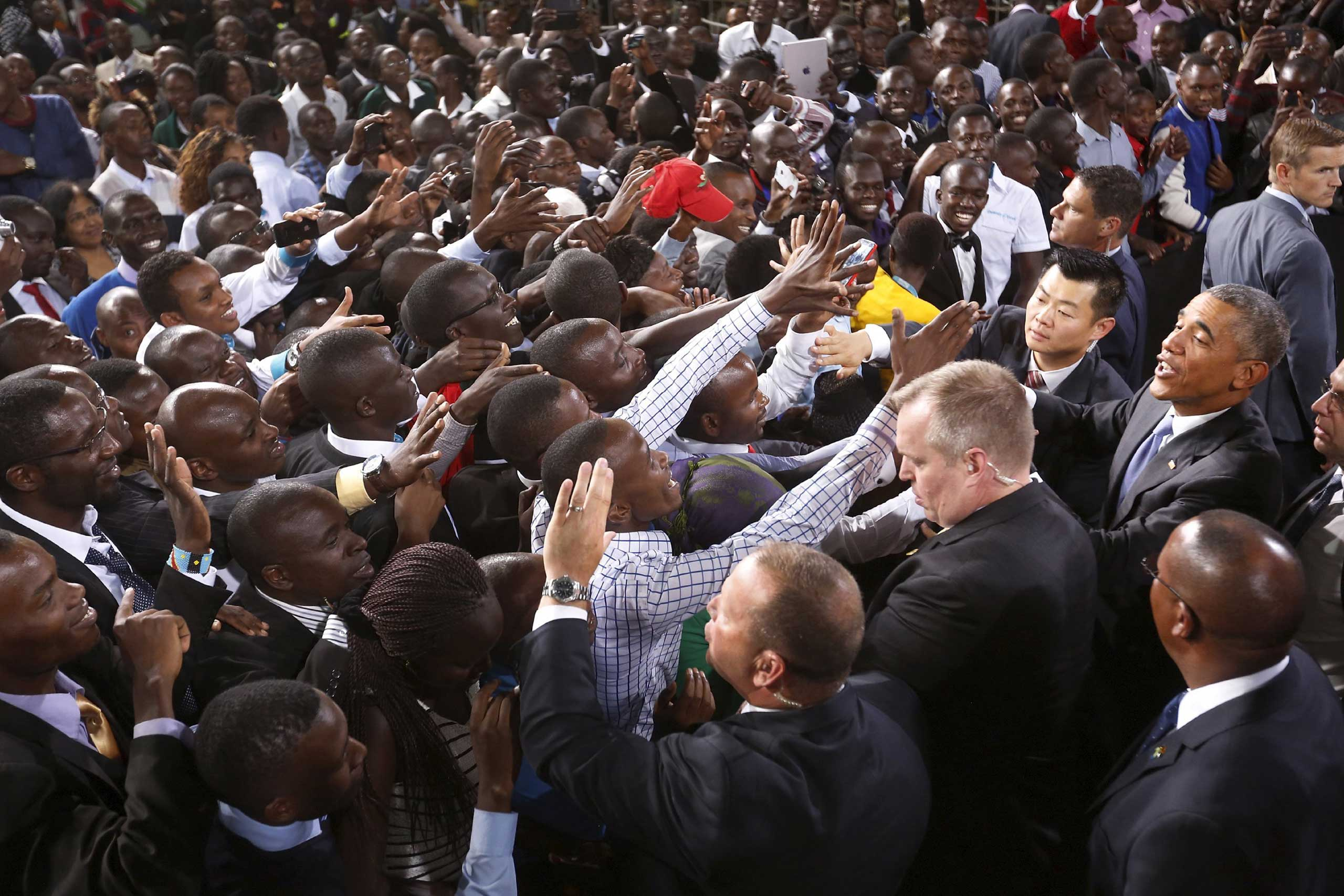 The crowd surges toward President Barack Obama as he greets the audience after his remarks at Safaricom Indoor Arena in Nairobi on July 26, 2015.