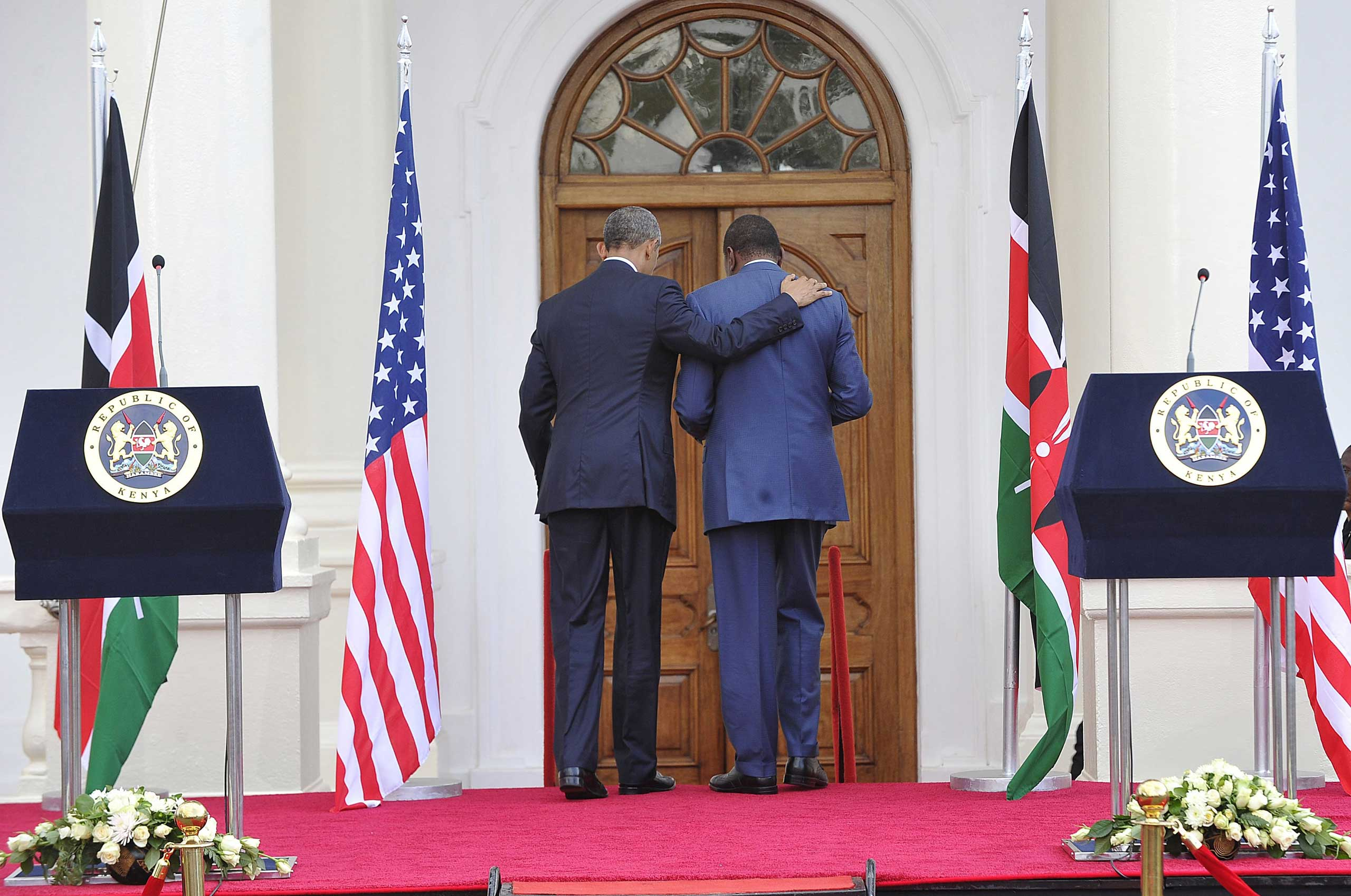 President Barack Obama and his Kenyan counterpart Uhuru Kenyatta leave after a joint press conference, discussing corruption, terrorism, and gay rights,  at the State House in Nairobi on July 25, 2015.