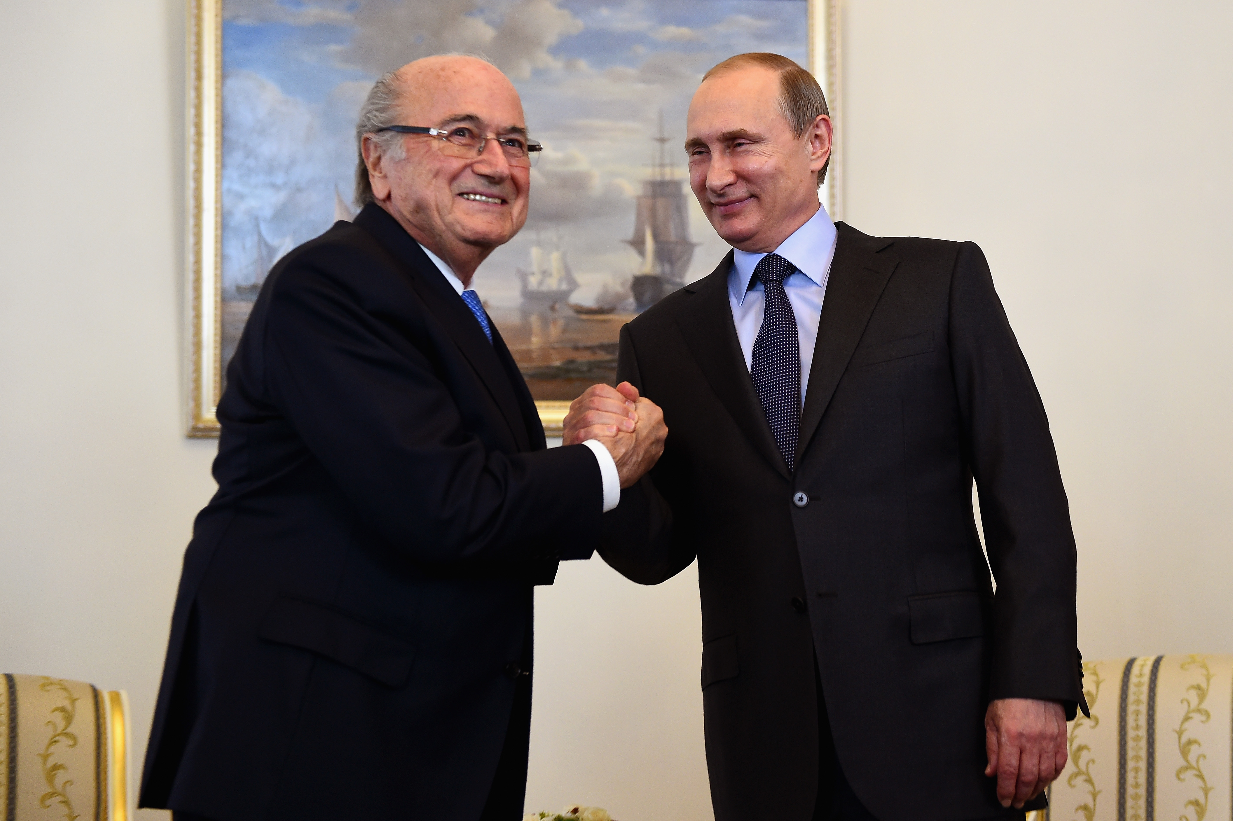 FIFA President Joseph S. Blatter shakes hands with Vladimir Putin, President of Russia ahead of the Preliminary Draw of the 2018 FIFA World Cup in Russia at The Konstantin Palace on July 25, 2015 in Saint Petersburg, Russia.