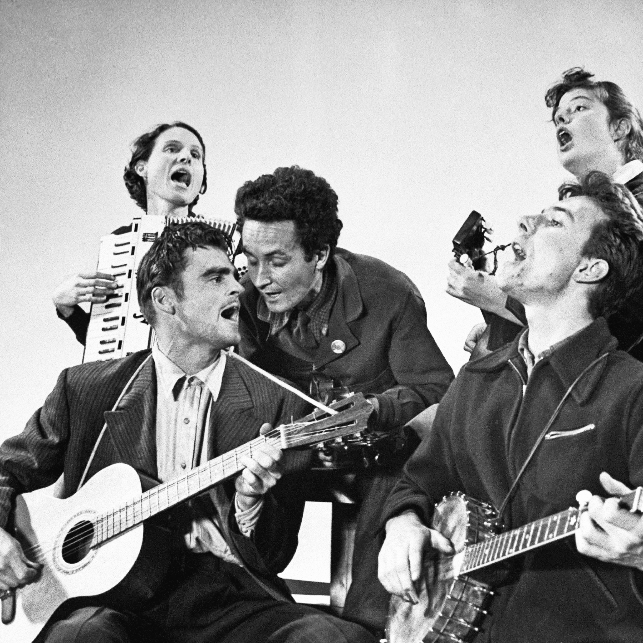 The Almanac Singers, Woody Guthrie (top center) and Pete Seeger (lower right) with Sis Cunningham, Cisco Houston, and Bess Lomax.