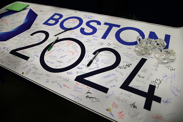 Signatures of support for Boston 2024 cover a banner on the table at a grassroots campaign in Boston on March 14, 2015.