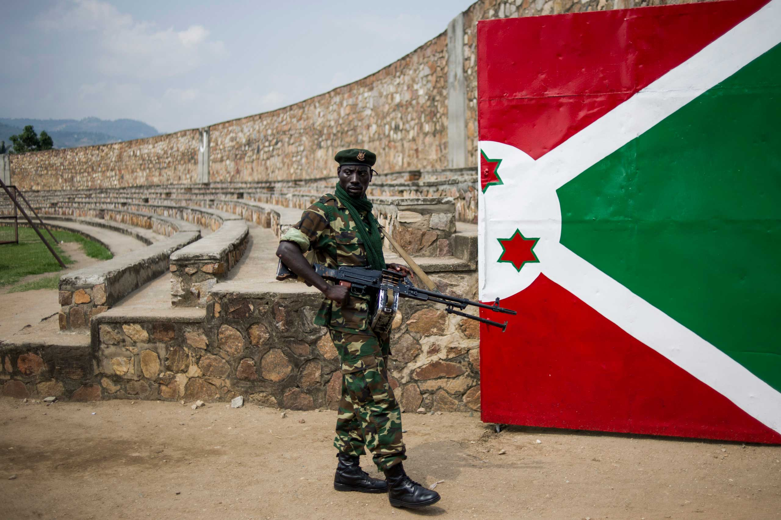 A soldier stands next to a gate painted with the Burundian flag at the Prince Rwagasore Stadium in Bujumbura, on June 27, 2015, during rehearsals for Independence Day celebrations on July 1.