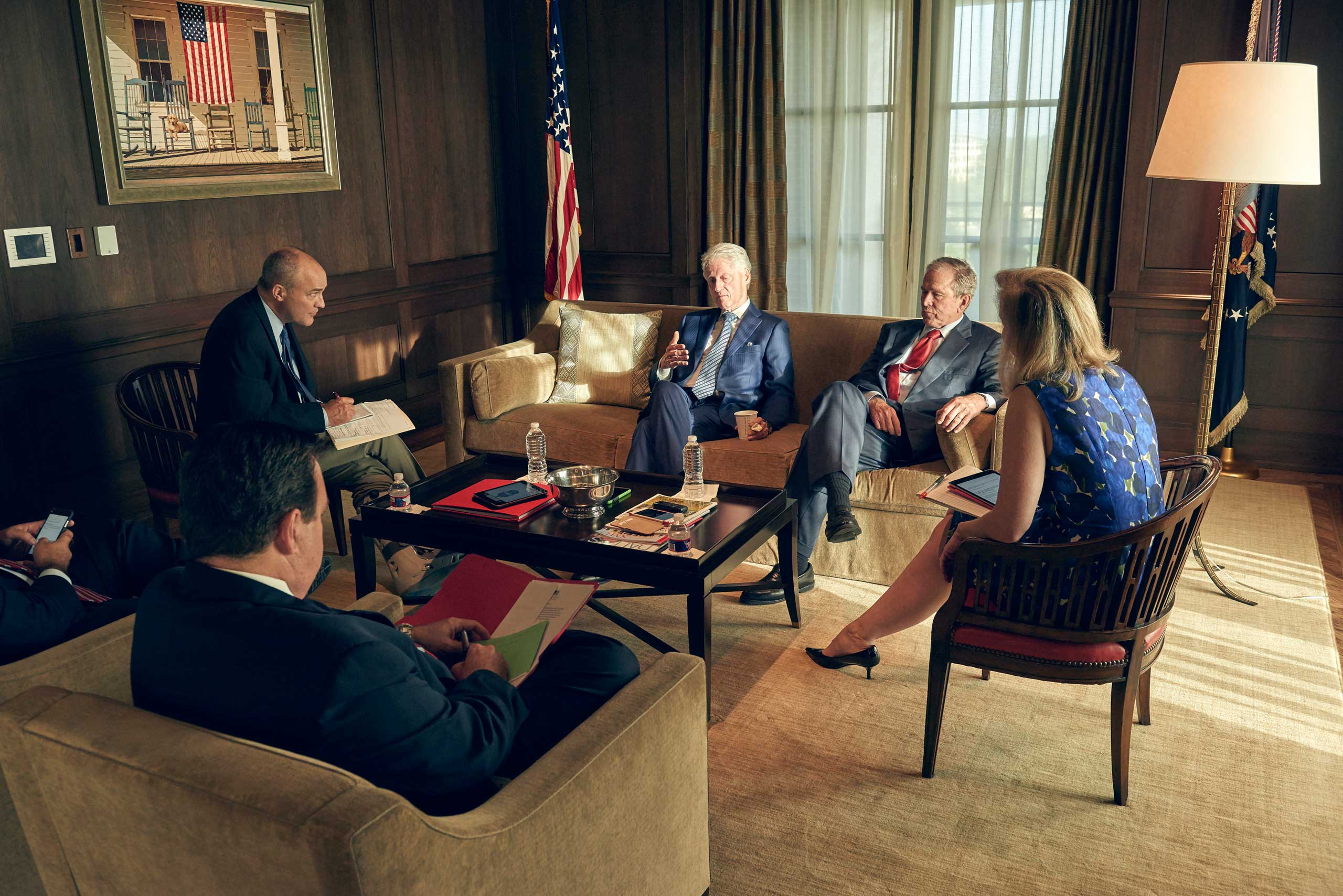 Former presidents Bill Clinton and George W. Bush in discussion with TIME's deputy managing editor Michael Duffy (far left) and editor Nancy Gibbs (right)