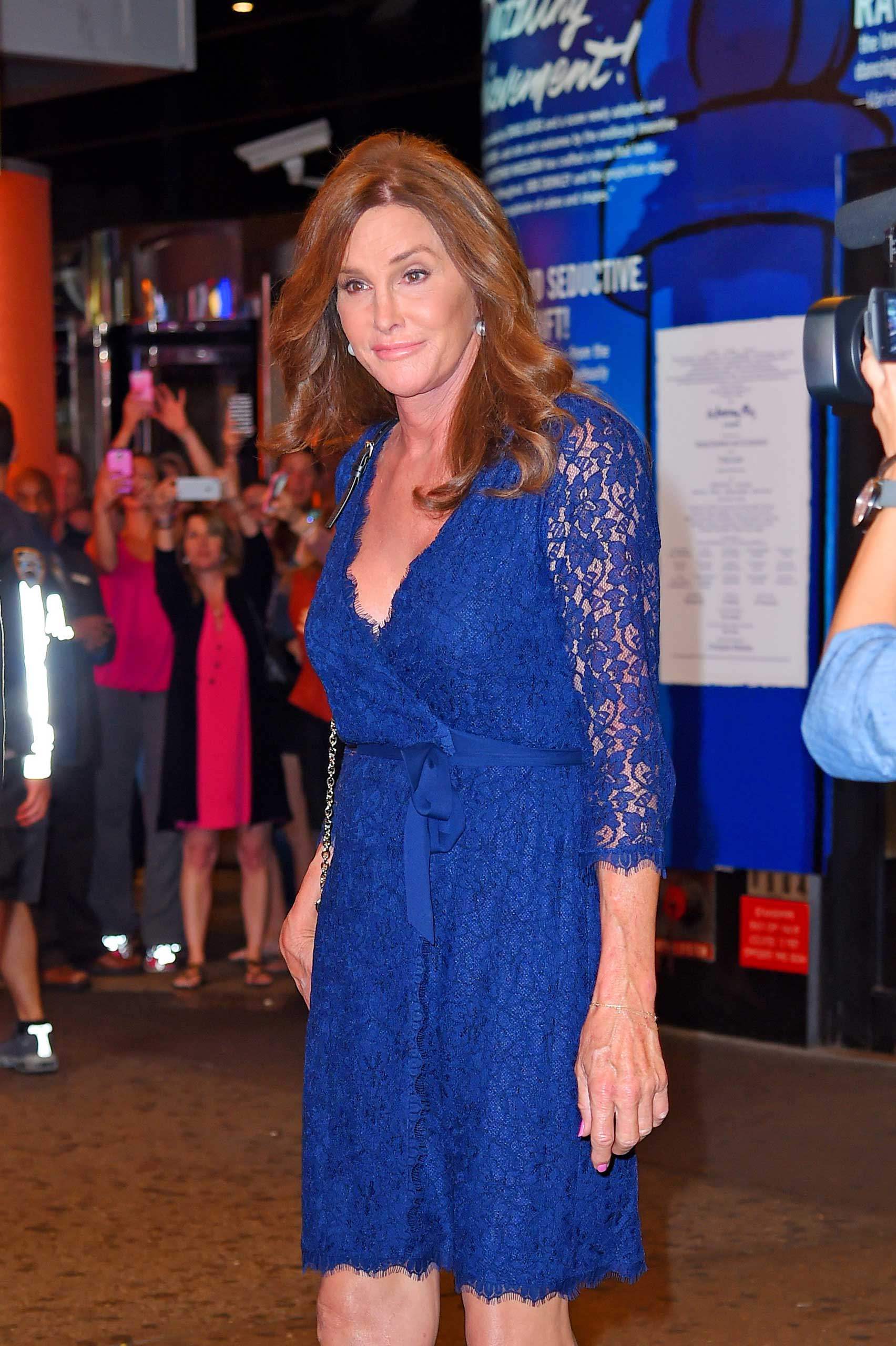 Caitlyn Jenner seen leaving 'An American in Paris' Broadway show in a bright blue lace dress on June 30, 2015 in New York.