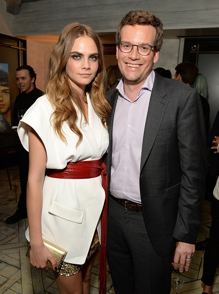 Cara Delevingne (L) and John Green at the afterparty for Los Angeles screening of  Paper Towns  in Hollywood on July 18, 2015.