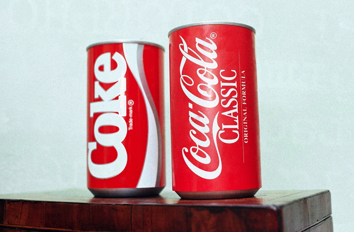 A July 11, 1985, file photo of cans of New Coke and Coca-Cola Classic  on display during a news conference in Atlanta.