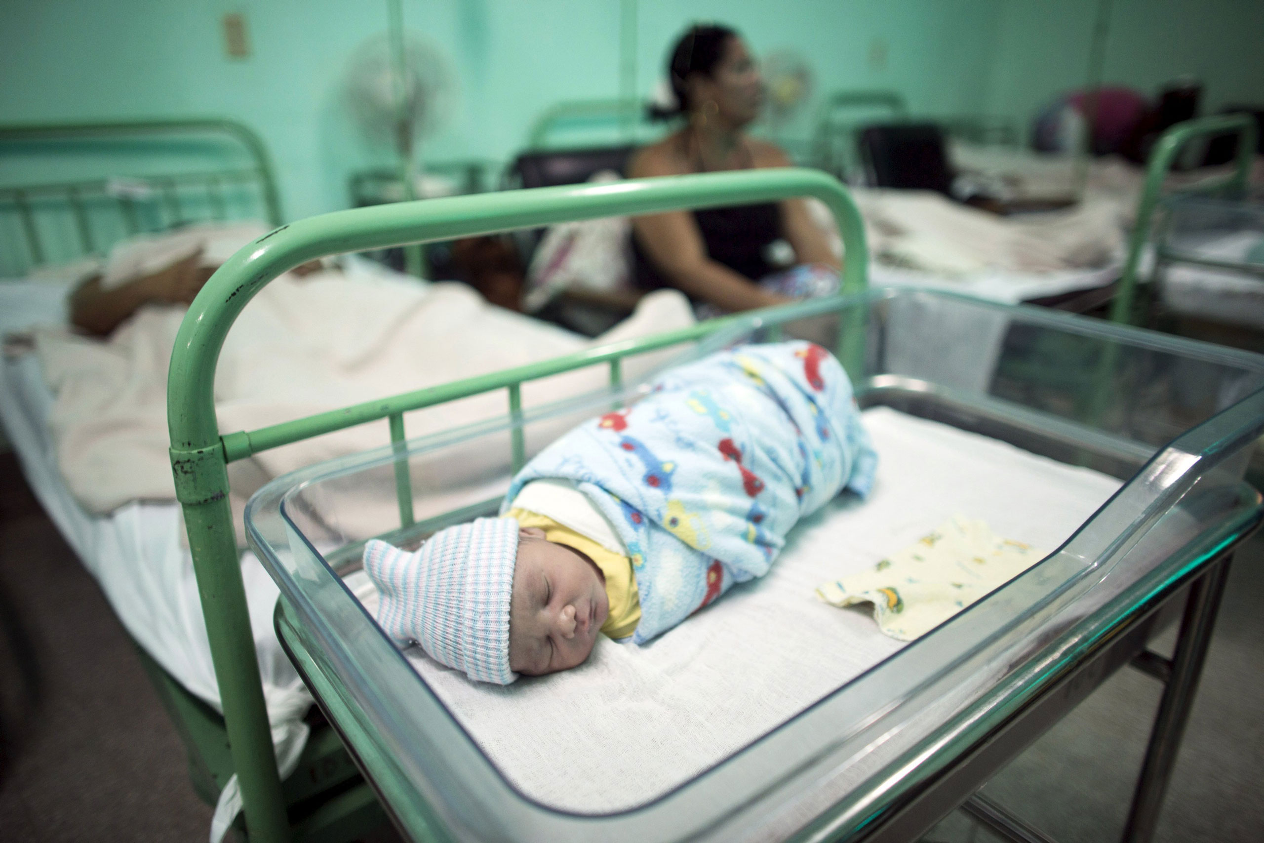 A new born baby rests beside his mother at the Ana Betancourt de Mora Hospital in Camaguey, Cuba, on June 19, 2015.