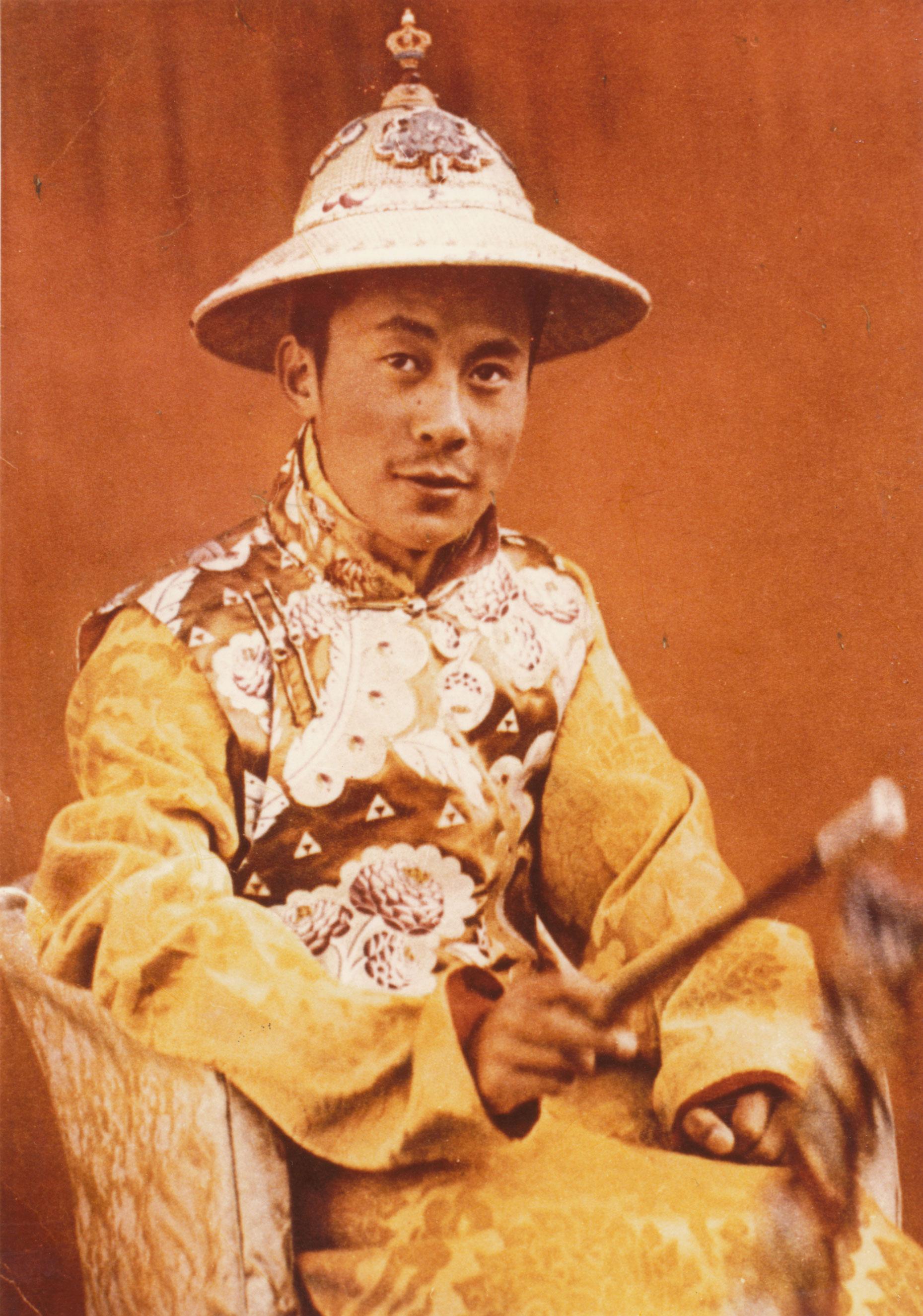 His Holiness wearing a ceremonial Tibetan chuba.
