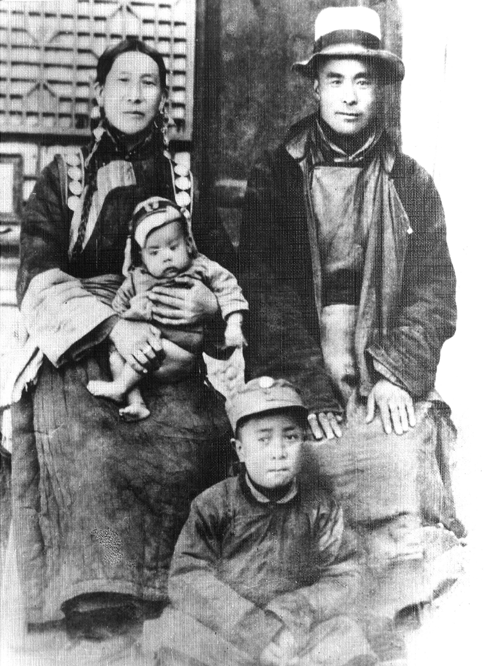 His Holiness as a baby with his mother Dekyi Tsering, father Choekyong Tsering and elder brother Gyalo Thondup taken in Taktser, Amdo Tibet, circa 1935.