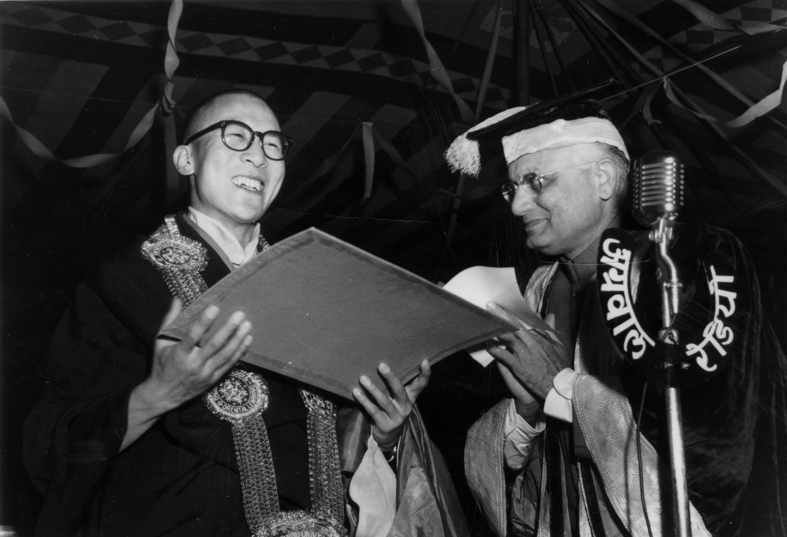 Dr. V.S. Jha, Vice-Chancellor of the Banaras Hindu University confers the an honorary Doctor of Letters on His Holiness the Dalai Lama at a special convocation in December 1956 in India.