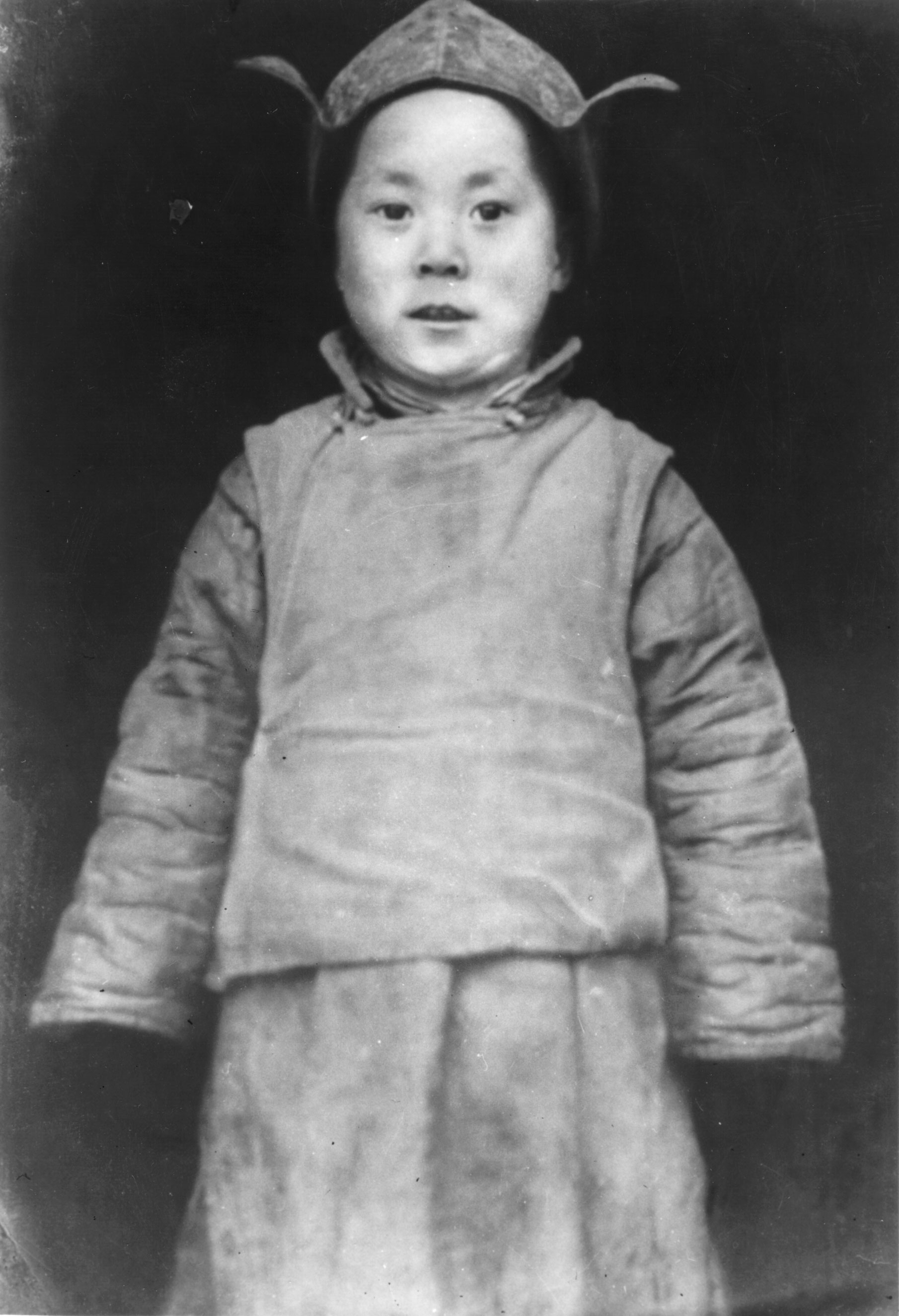 His Holiness at age 4 posing soon after the search party discovered him in 1939 in Kumbum, Amdo, Tibet.