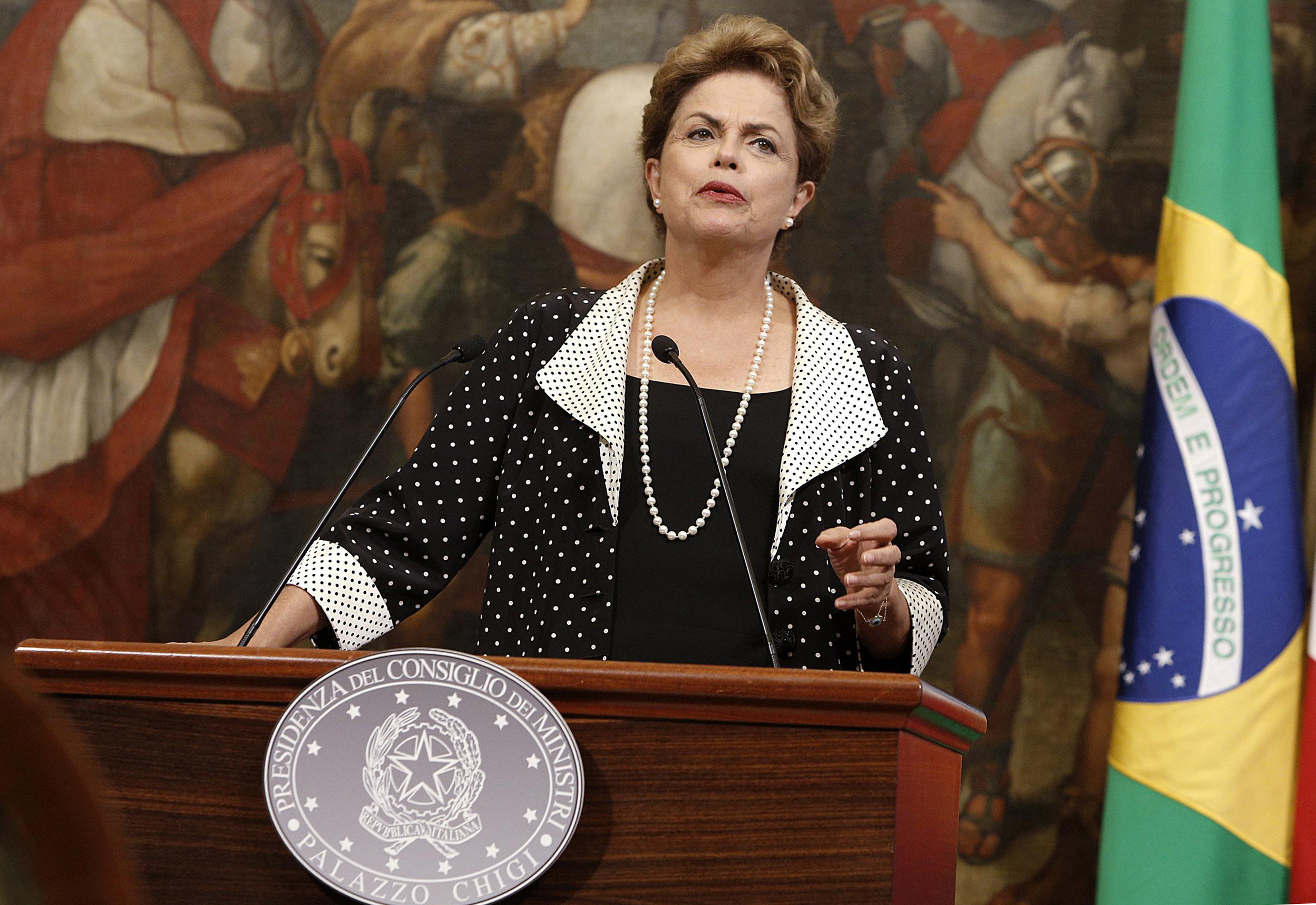 Brazilian President Dilma Rousseff speaks during a joint press conference with Italian Premier Matteo Renzi, at Chigi's Premier Palace in Rome on July 10, 2015.