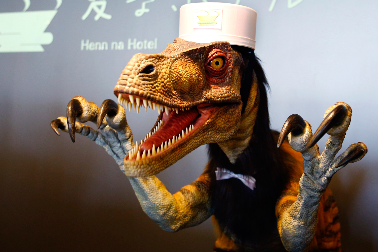 A receptionist dinosaur robot performs at the new robot hotel, aptly called Henn na Hotel or Weird Hotel, in Sasebo, southwestern Japan, July 15, 2015.
