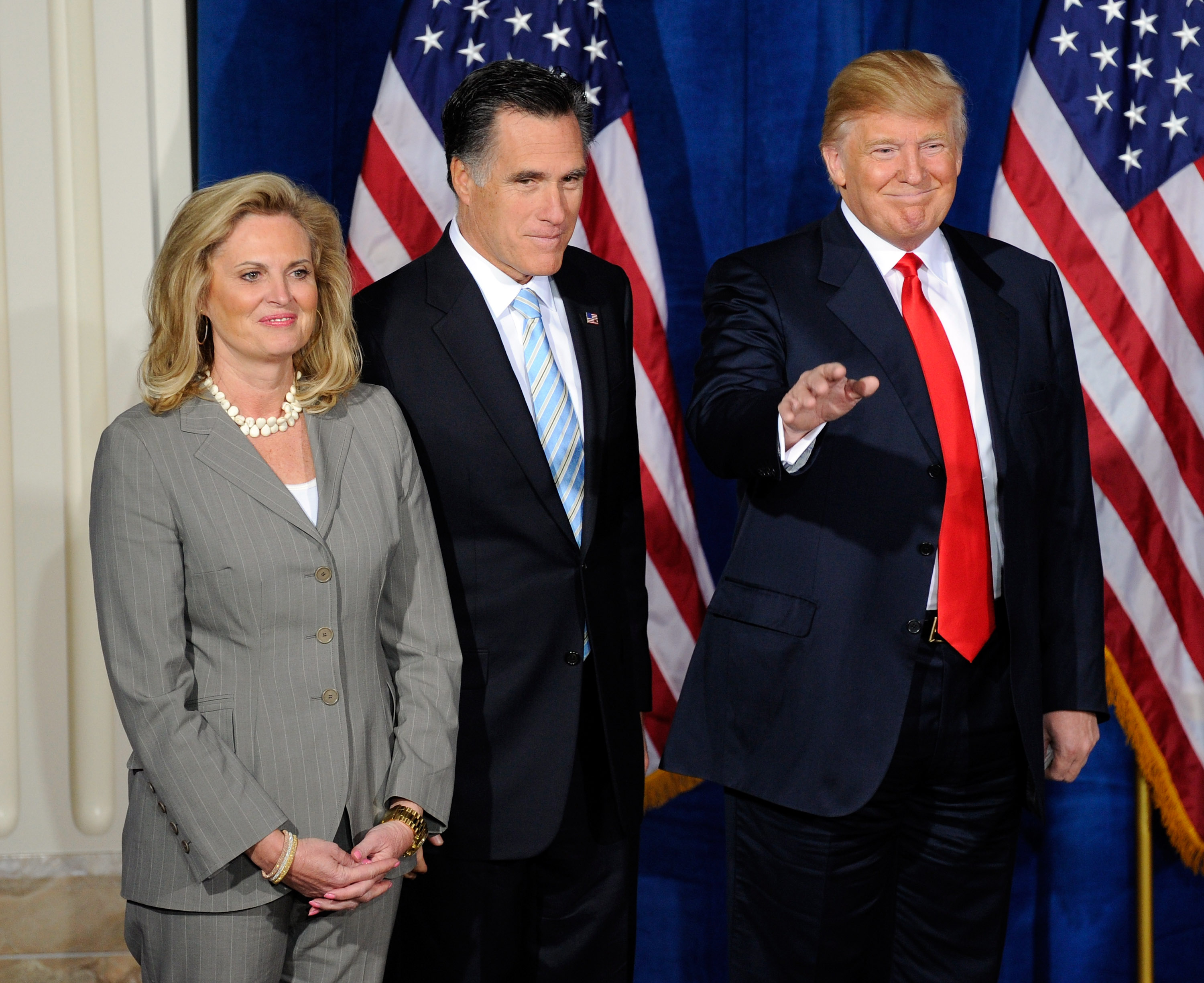 Donald Trump appears at a news conference to endorse Republican presidential candidate, former Massachusetts Gov. Mitt Romney as his wife Ann Romney looks on at the Trump International Hotel & Tower Las Vegas in Las Vegas on February 2, 2012.