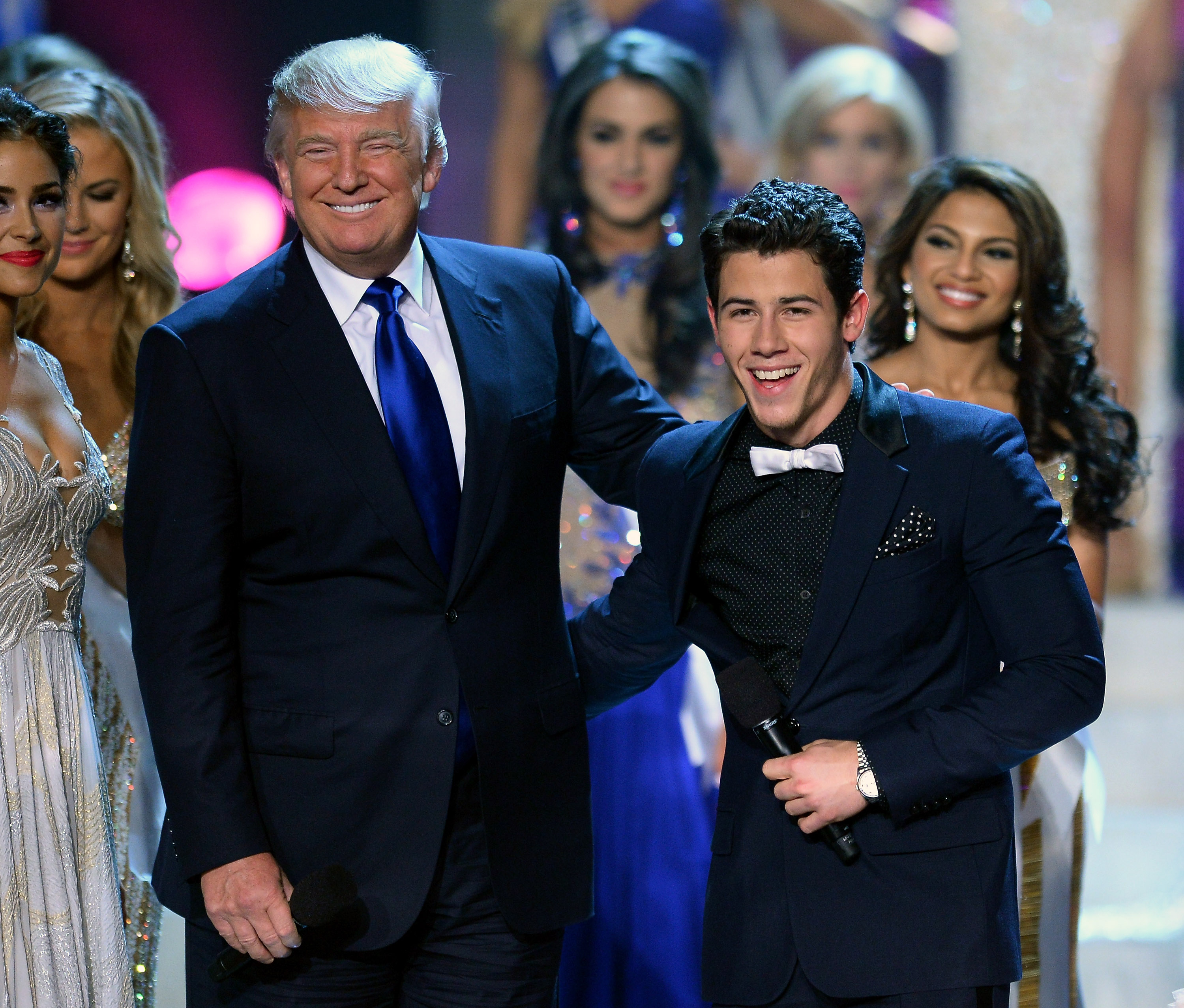 Donald Trump and recording artist and host Nick Jonas joke around onstage during the 2013 Miss USA pageant at PH Live at Planet Hollywood Resort & Casino on June 16, 2013 in Las Vegas.