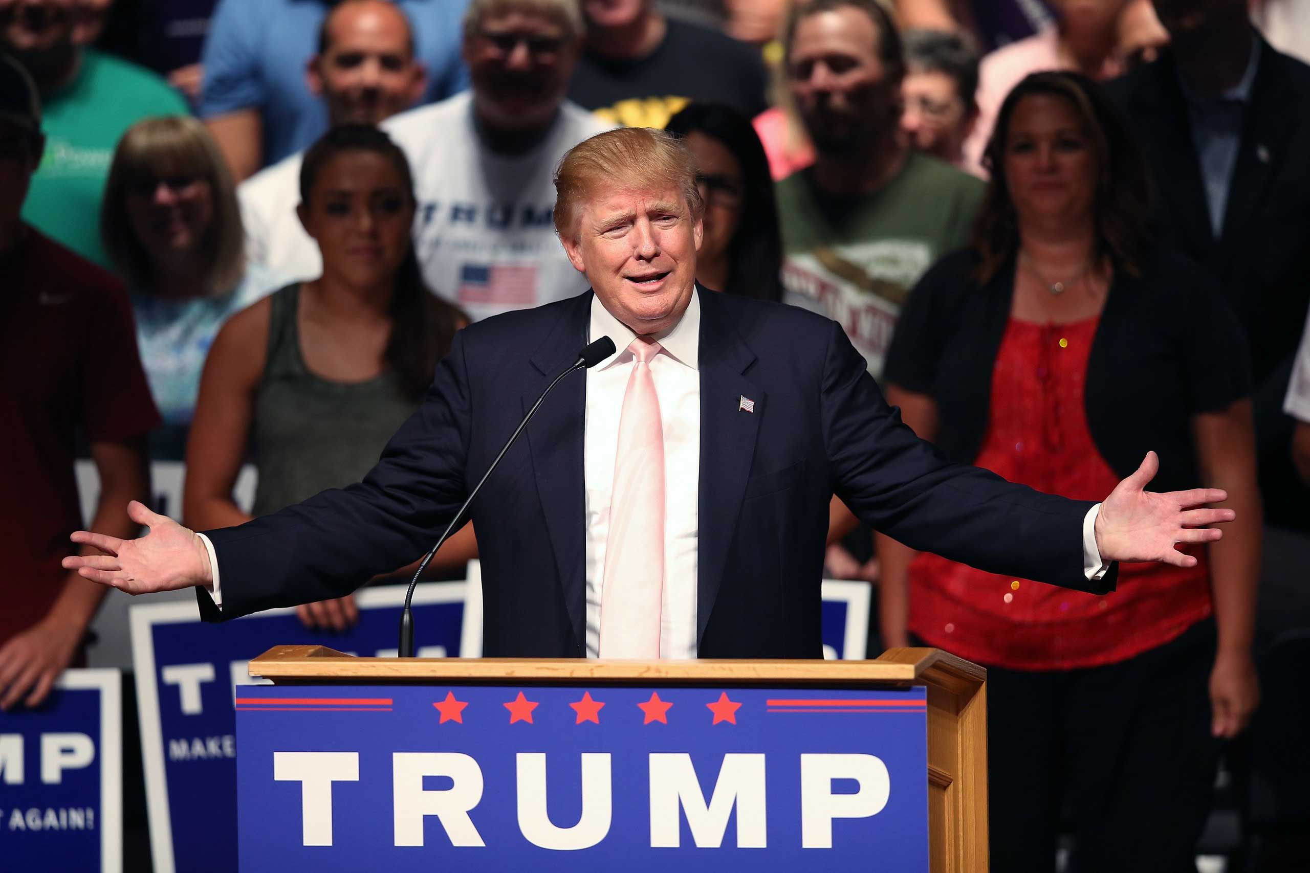 Republican presidential hopeful businessman Donald Trump speaks to guests gathered for a rally on in Oskaloosa, Iowa on July 25, 2015.