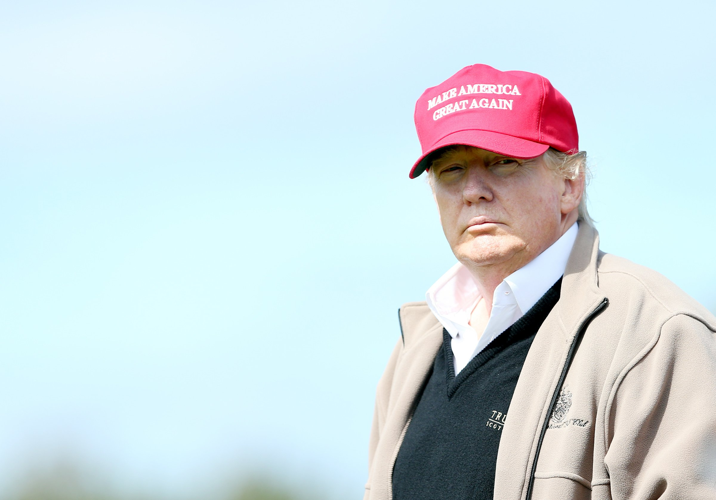 Presidential contender Donald Trump looks on at the 16th green on the 1st first day of the Women's British Open golf championship on the Turnberry golf course in Turnberry, Scotland on July 30, 2015.