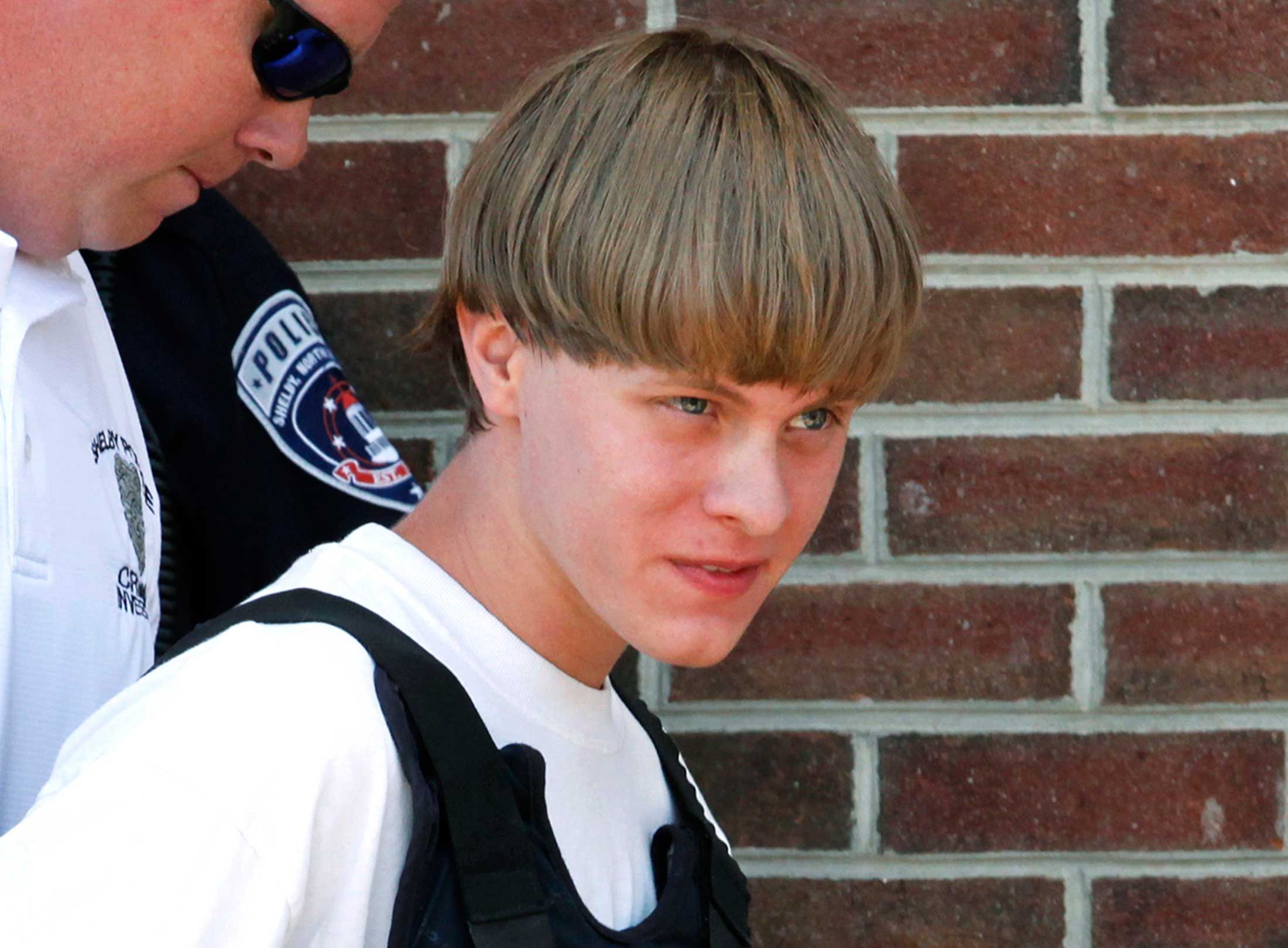 Police lead suspected shooter Dylann Roof into the courthouse in Shelby, North Carolina, June 18, 2015.