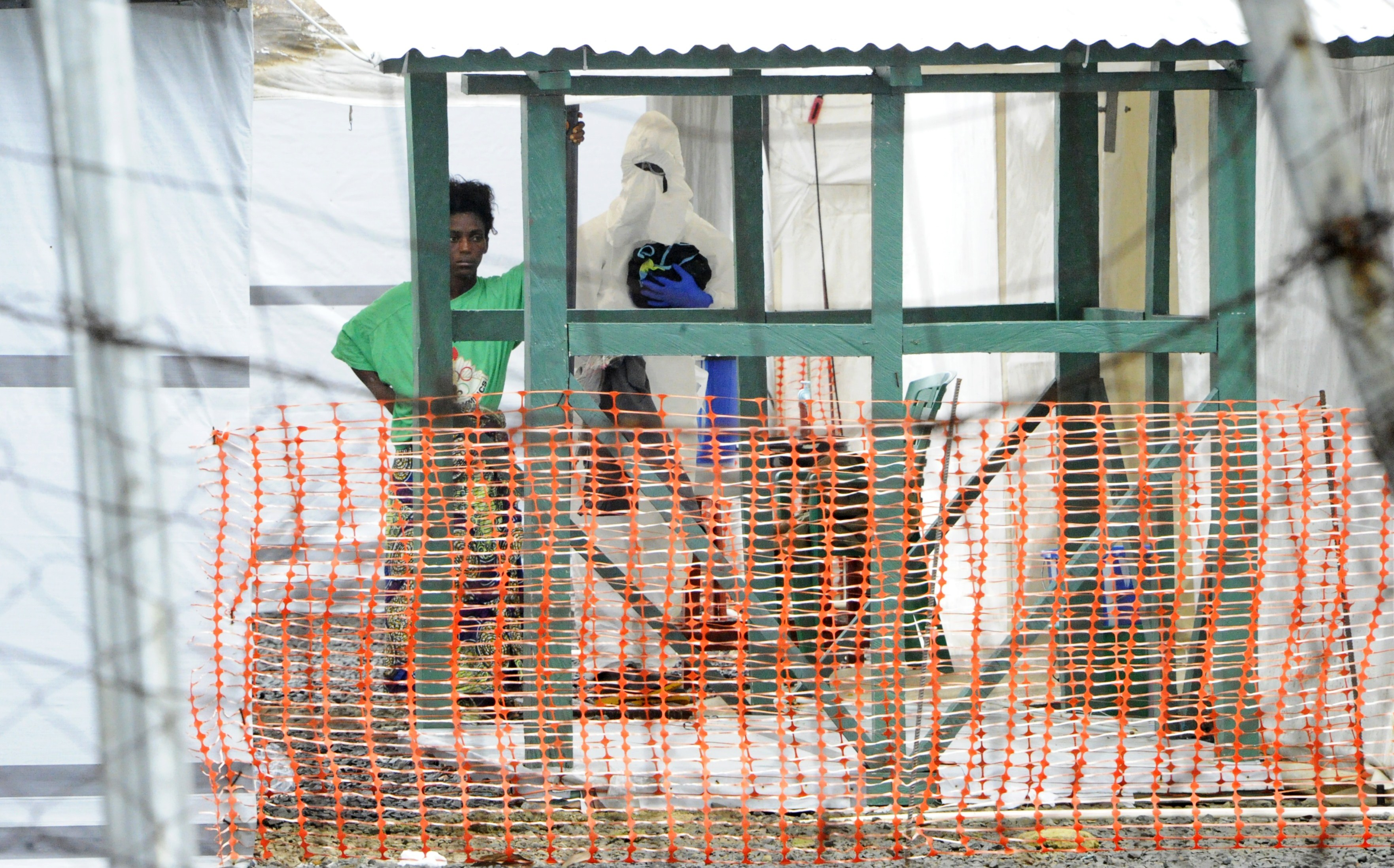 A woman, suspected of carrying ebola, looks on while under quarantine in the red zone of the Elwa clinic, an ebola treatment center in Monrovia on July 20, 2015. AFP PHOTO / ZOOM DOSSO        (Photo credit should read ZOOM DOSSO/AFP/Getty Images)