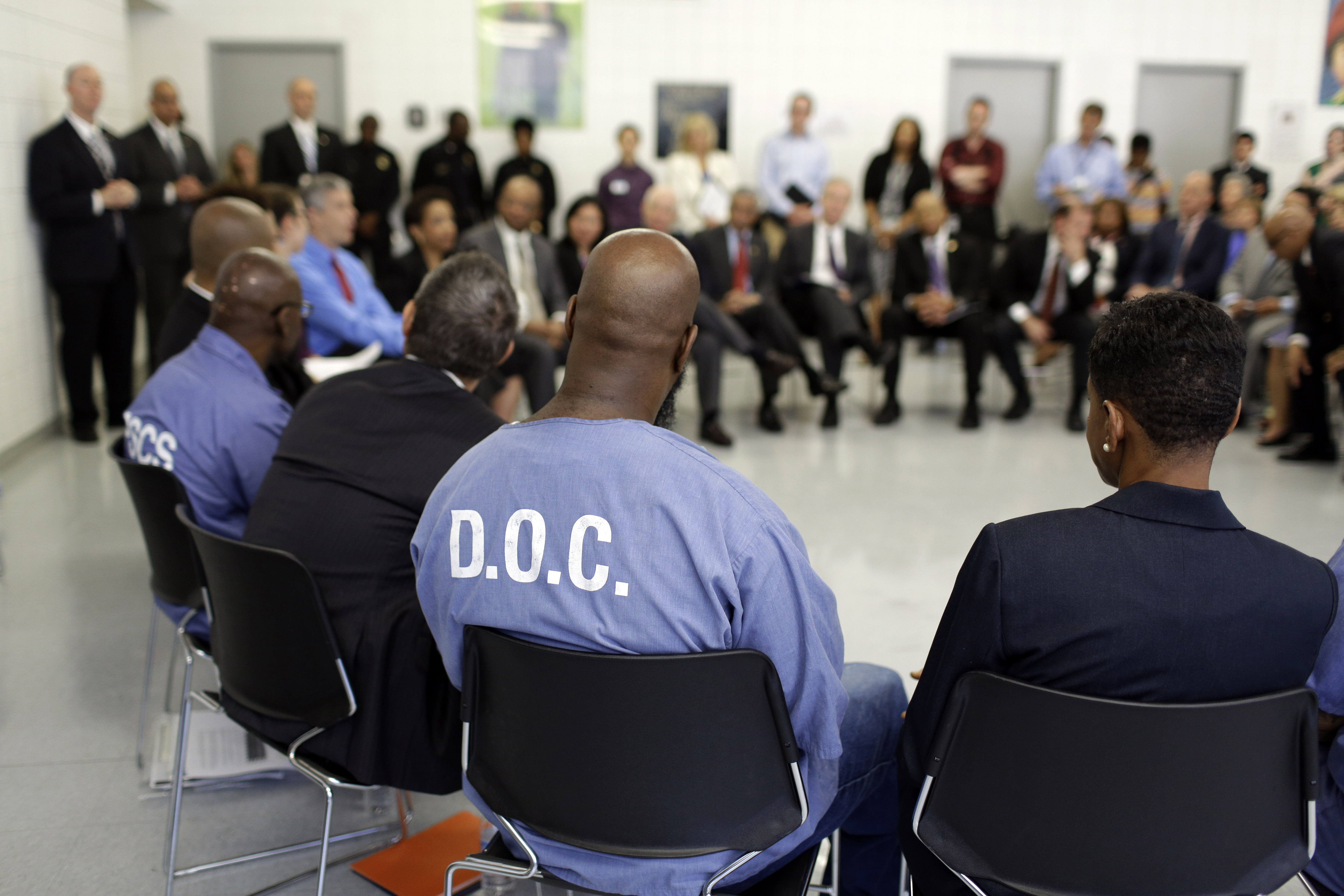 Inmate Alphonso Coats, a participant in the Goucher College Prison Education Partnership, sits in a discussion with Attorney General Loretta Lynch, Education Secretary Arne Duncan and other officials inside the Maryland Correctional Institution-Jessup on July 31, 2015, in Jessup, Md.