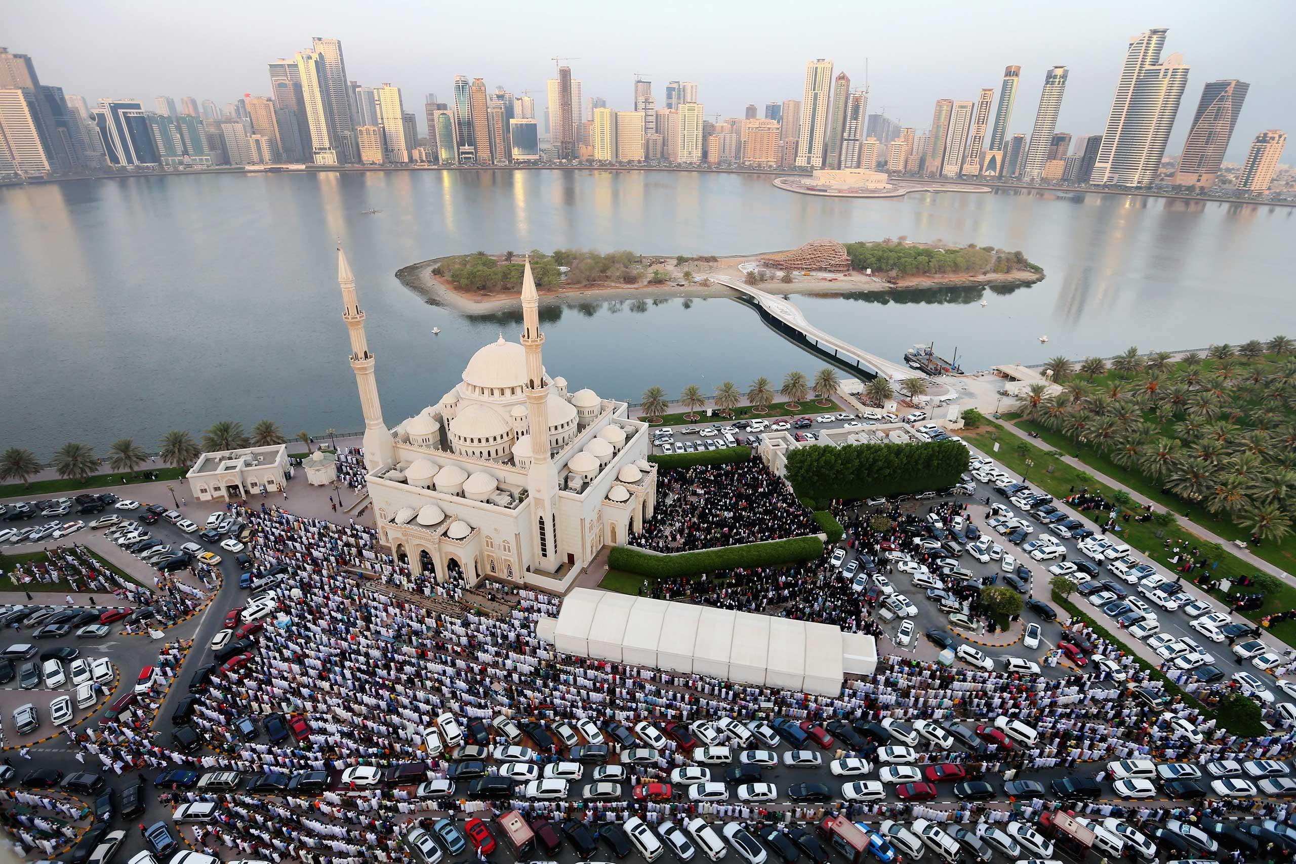 Muslims offer Eid al-Fitr prayers outside Al Noor Mosque in Sharjah, United Arab Emirates, on July 17, 2015.