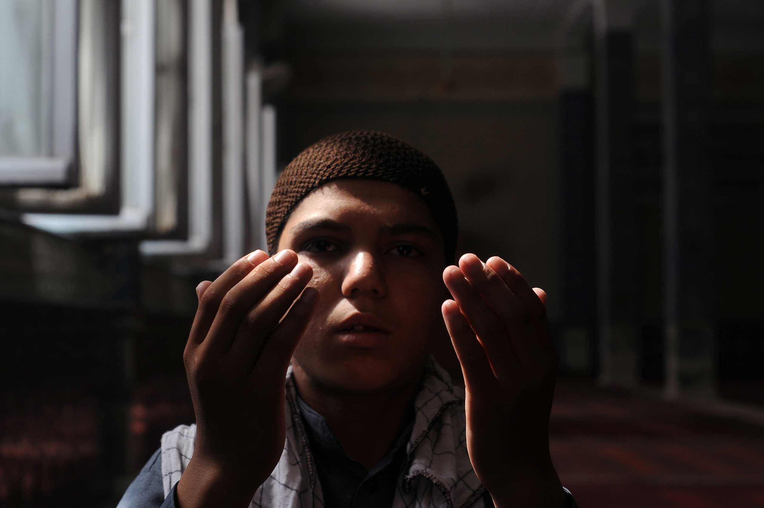 An Afghan boy attends Eid al-Fitr prayers in Mazar-i-Sharif, Afghanistan, on July 17, 2015.