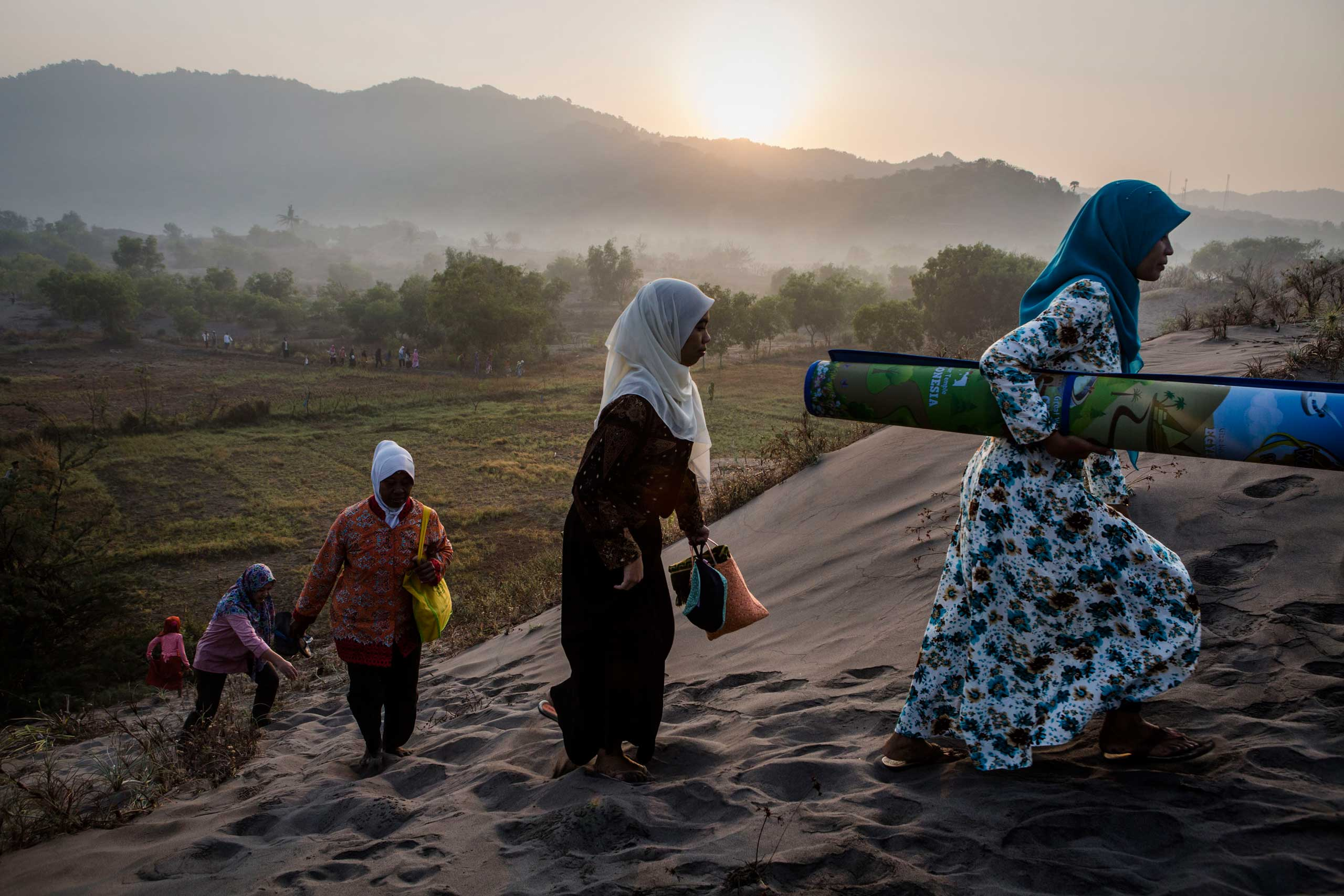 Indonesian muslims walk on 'sea of sands' as they prepare for Eid Al-Fitr prayer at Parangkusumo beach in Yogyakarta, Indonesia, on July 17, 2015.